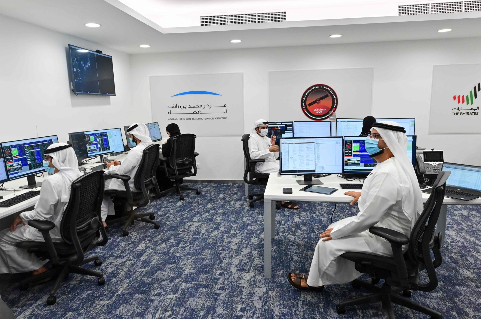 "Staff work at the Mohammed Bin Rashid Space Centre in Dubai, ahead of the expected launch of the ""Hope"" Mars probe from Japan, July 19, 2020. (AFP Photo)"