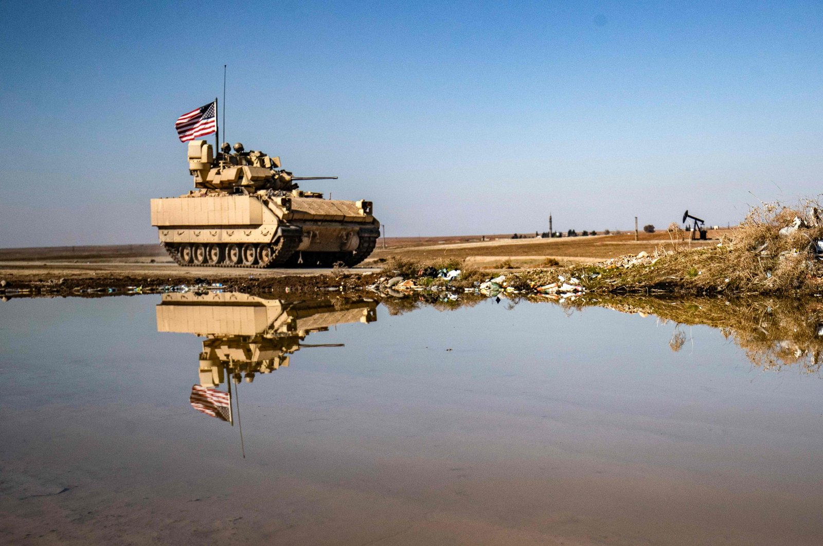A U.S. Bradley Fighting Vehicle (BFV) patrols in the countryside near al-Malikiyah (Derik) in Syria's northeastern Hasakah province, Feb. 2, 2021. (AFP Photo)