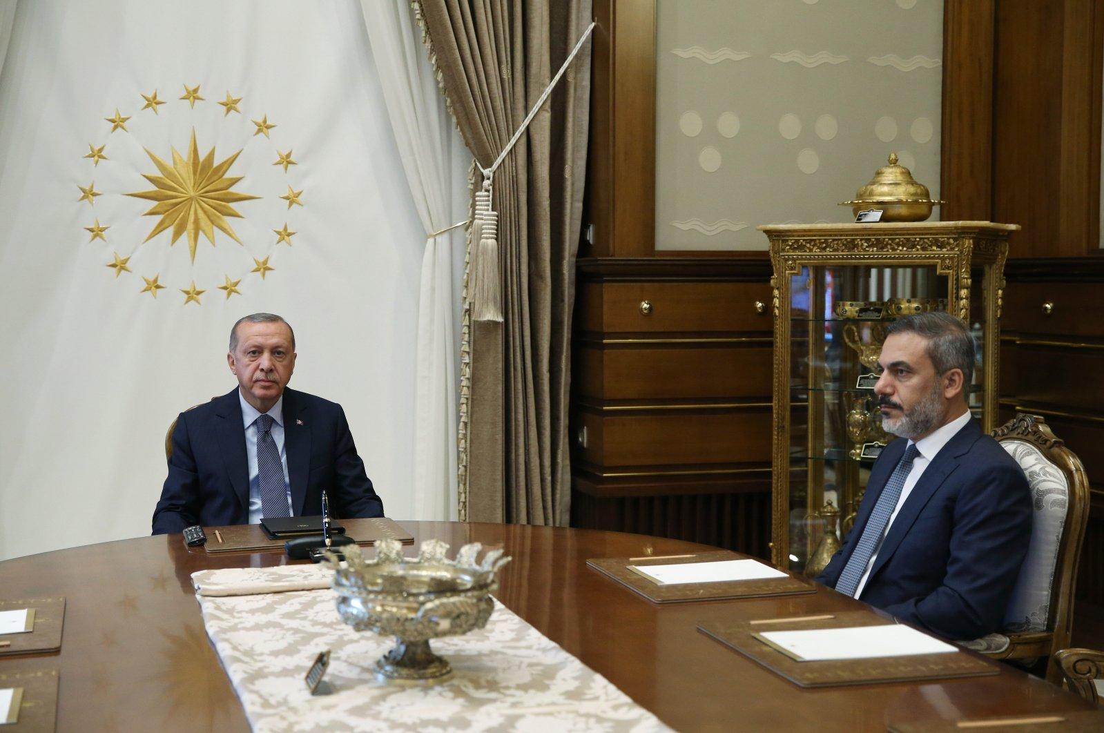 President Recep Tayyip Erdoğan (L) receives National Intelligence Organization (MIT) chief Hakan Fidan at the Presidential Complex in the capital Ankara on Aug. 10, 2018. (DHA File Photo)