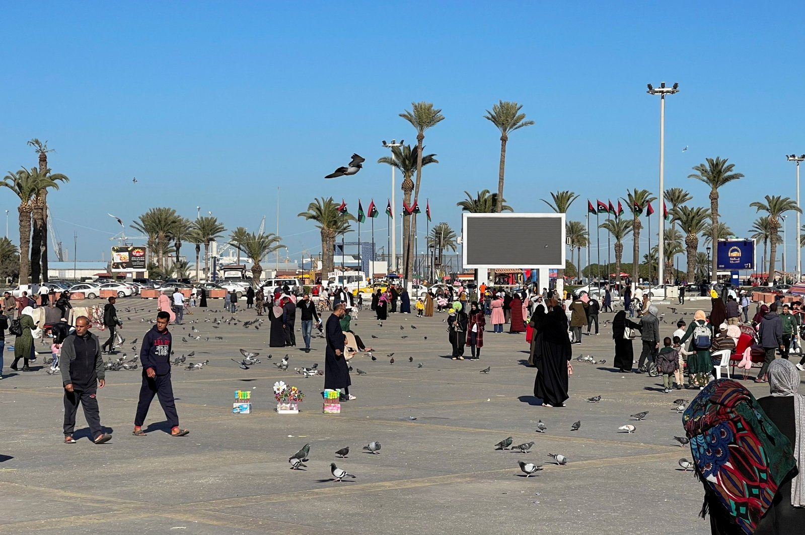 People walk at Martyrs' Square in the early hours of Friday afternoon in Tripoli, Libya, February 5, 2021. (REUTERS Photo)