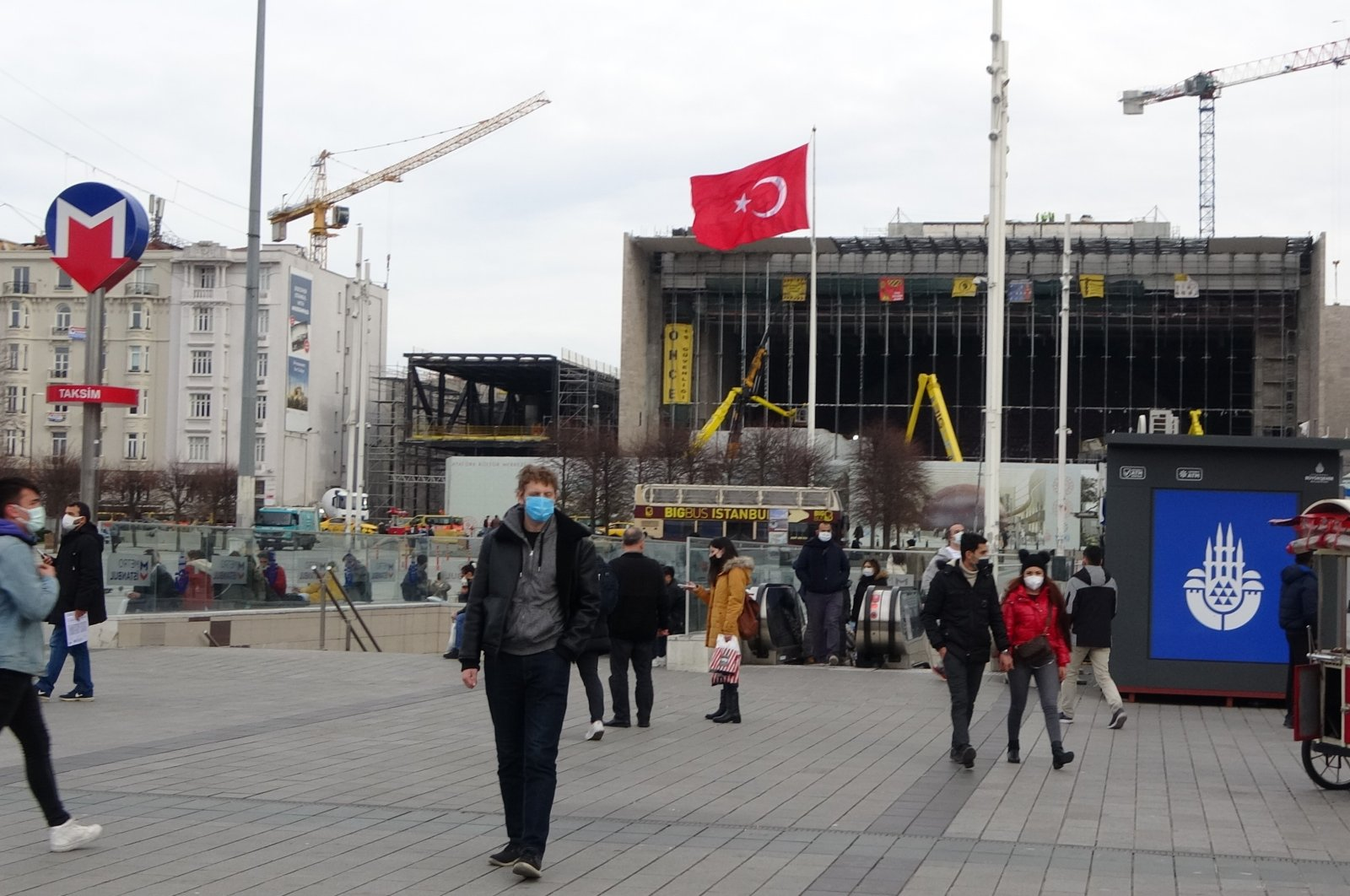People wearing masks walk in Istanbul's Taksim Square, Turkey, Feb. 1, 2021. (IHA Photo)