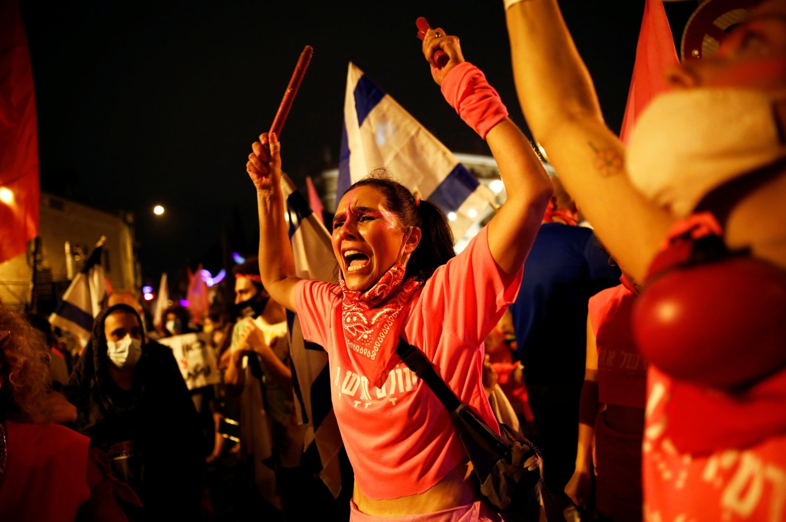 """""""The Pink Front,"""" a group of protesters demanding Israeli Prime Minister Benjamin Netanyahu to step down over corruption allegations, during a weekly anti-Netanyahu demonstration, in Jerusalem, Israel, Oct. 24, 2020. (Reuters Photo)"""
