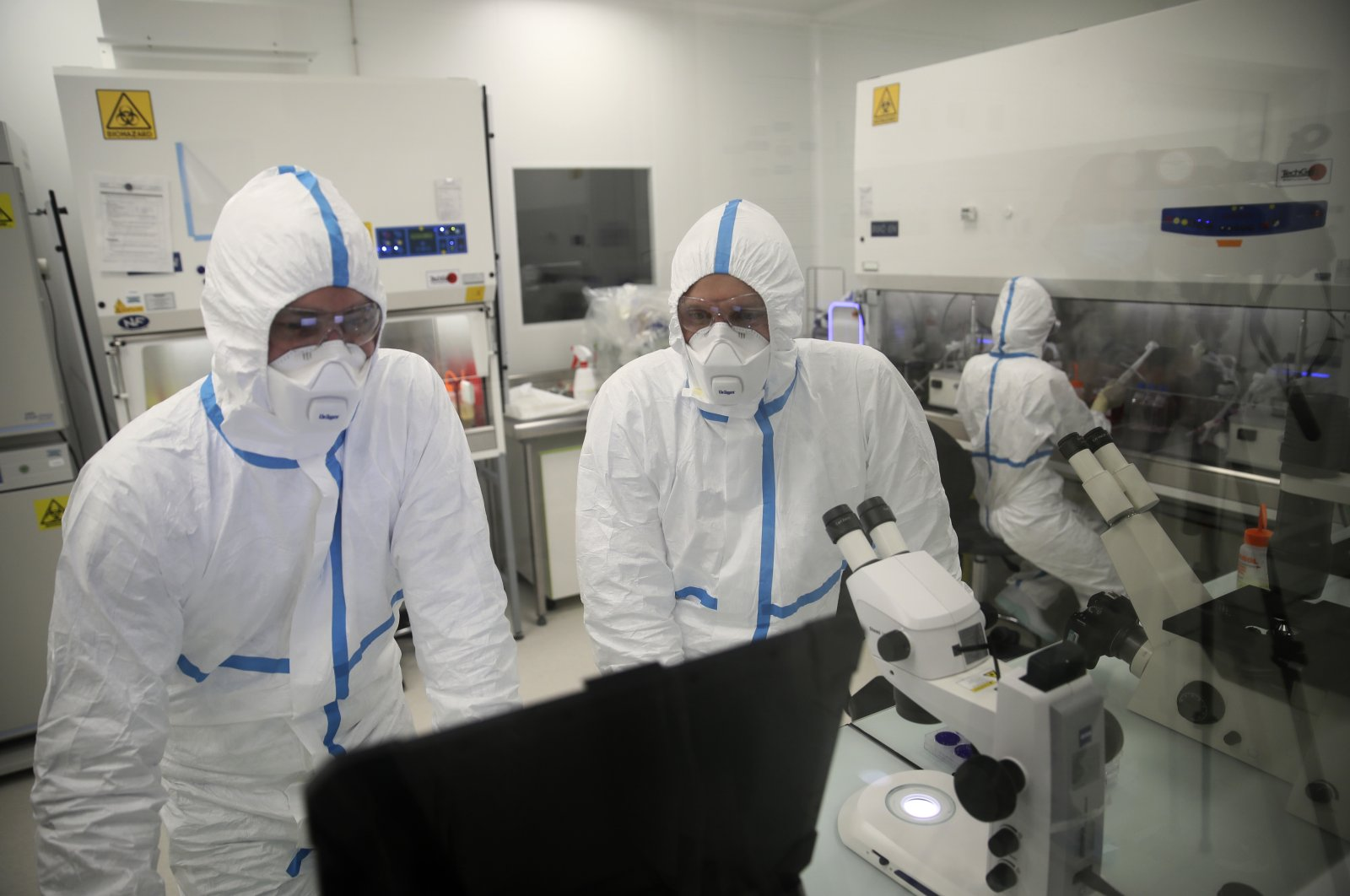 Laboratory technicians work at Valneva headquarters in Saint-Herblain, western France, Feb. 3, 2021. (AP Photo)