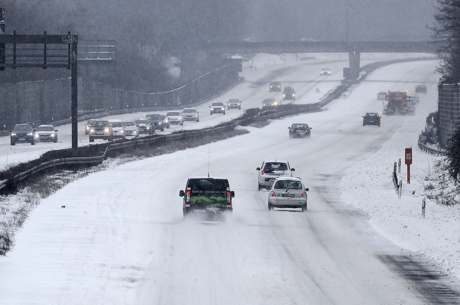 Cars driving carefully on the snowy Autobahn A2 in Gelsenkirchen, Germany, Sunday, Feb. 7, 2021. (AP Photo)