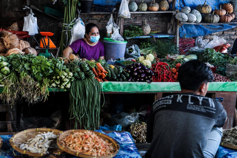 Vegetable vendors wait for customers at a market in Medan, North Sumatra, Indonesia, Feb. 2, 2021. (EPA Photo)