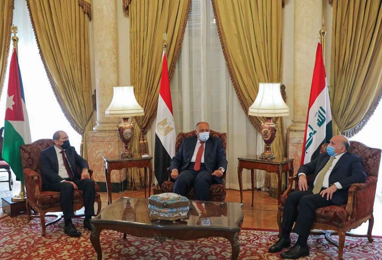 A handout picture released by the Egyptian Ministry of Foreign Affairs shows Foreign Minister Sameh Shoukry (C) meeting with his counterparts, Jordanian Ayman Safadi (L) and Iraqi Fouad Hussein, at al-Tahrir Palace in the capital Cairo's Tahrir Square on Feb. 8, 2021. (AFP)