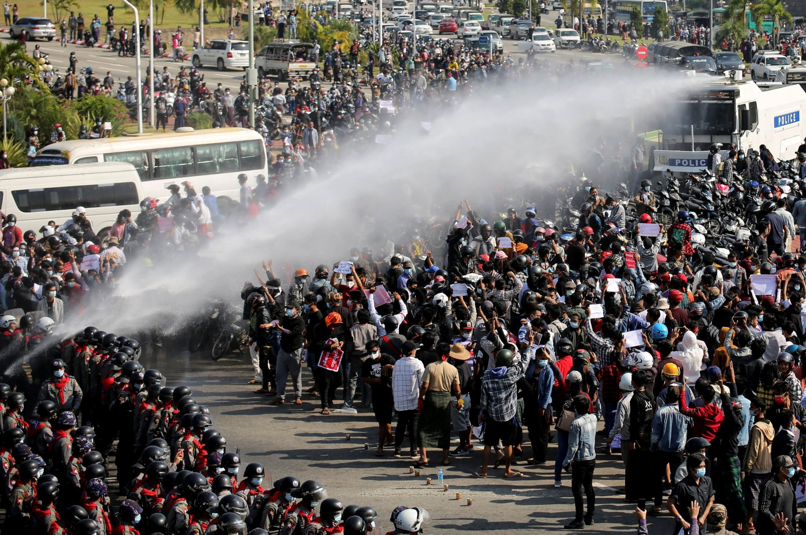 Police fire a water cannon at protesters demonstrating against the coup and demanding the release of elected leader Aung San Suu Kyi, in Naypyitaw, Myanmar, Feb. 8, 2021. (Reuters Photo)
