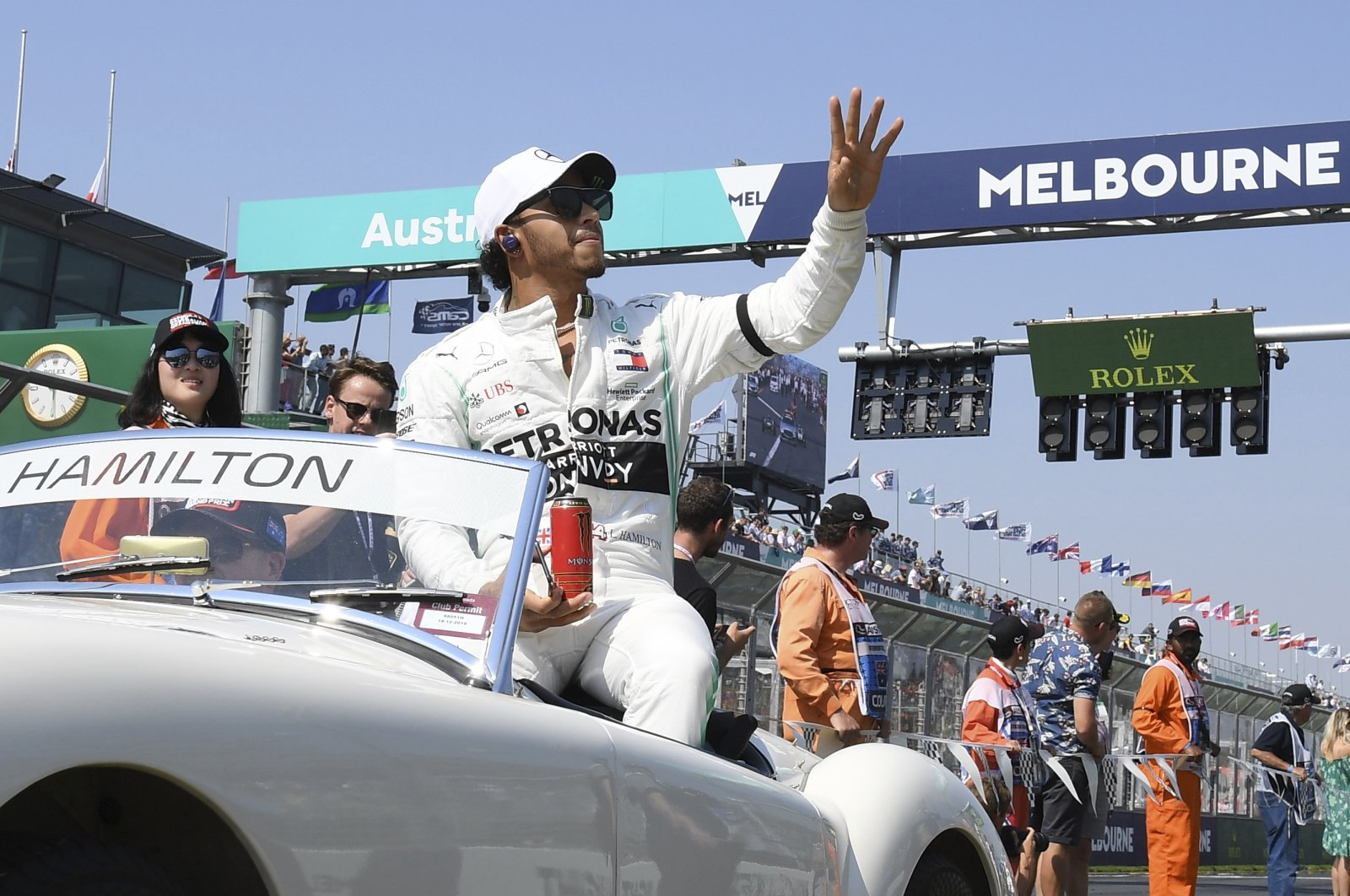 In this March 17, 2019, file photo, Mercedes driver Lewis Hamilton of Britain waves as the drivers parade begins ahead of the Australian Grand Prix in Melbourne, Australia. (AP Photo)
