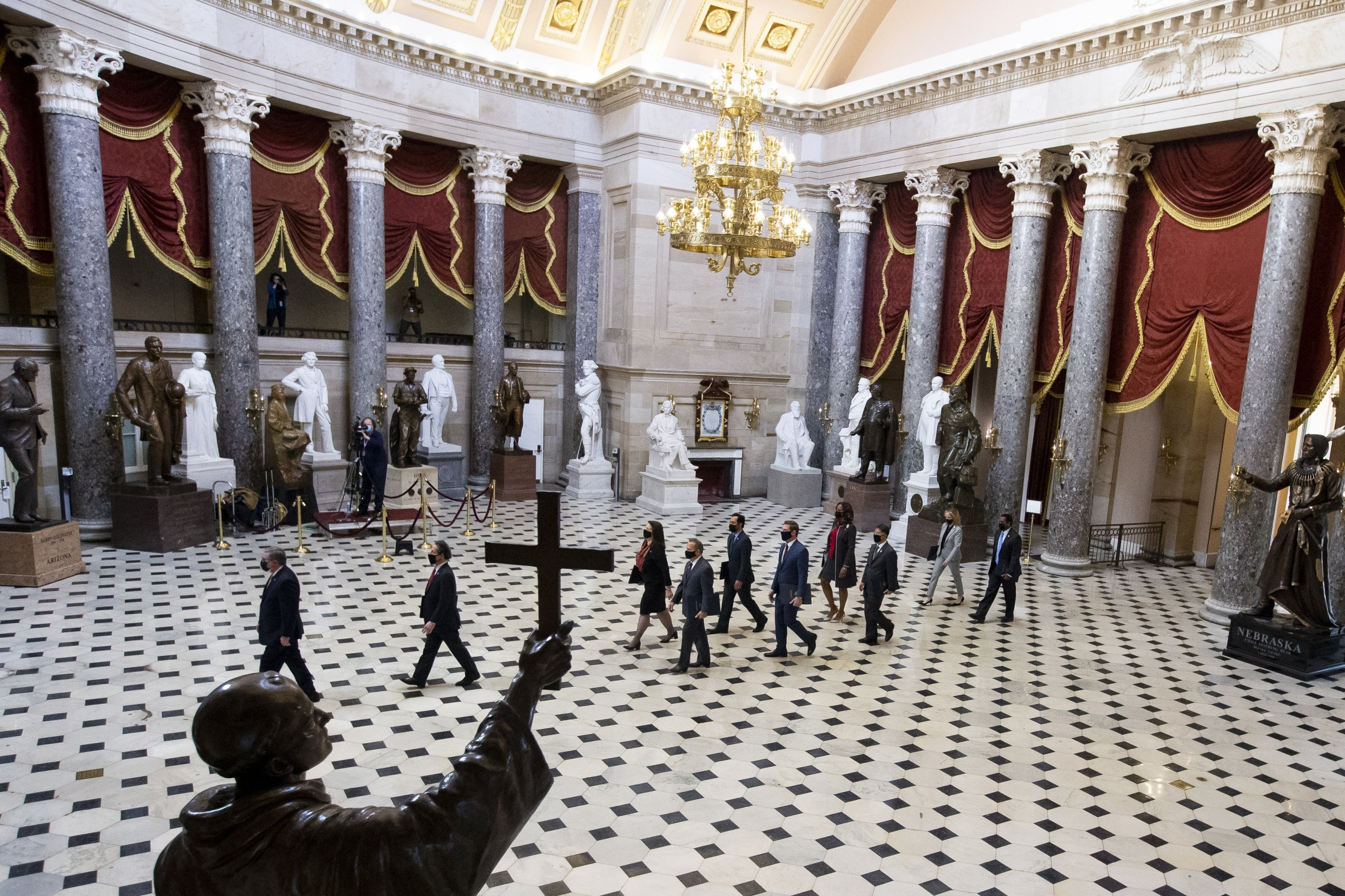 House impeachment managers, led by Acting Sergeant at Arms of the United States House of Representatives Tim Blodgett (L), walk through National Statuary Hall on their way to the Senate chamber for the start of the Senate impeachment trial against former U.S. President Donald J. Trump, on Capitol Hill in Washington, D.C., U.S., Feb. 9, 2021. (EPA Photo)