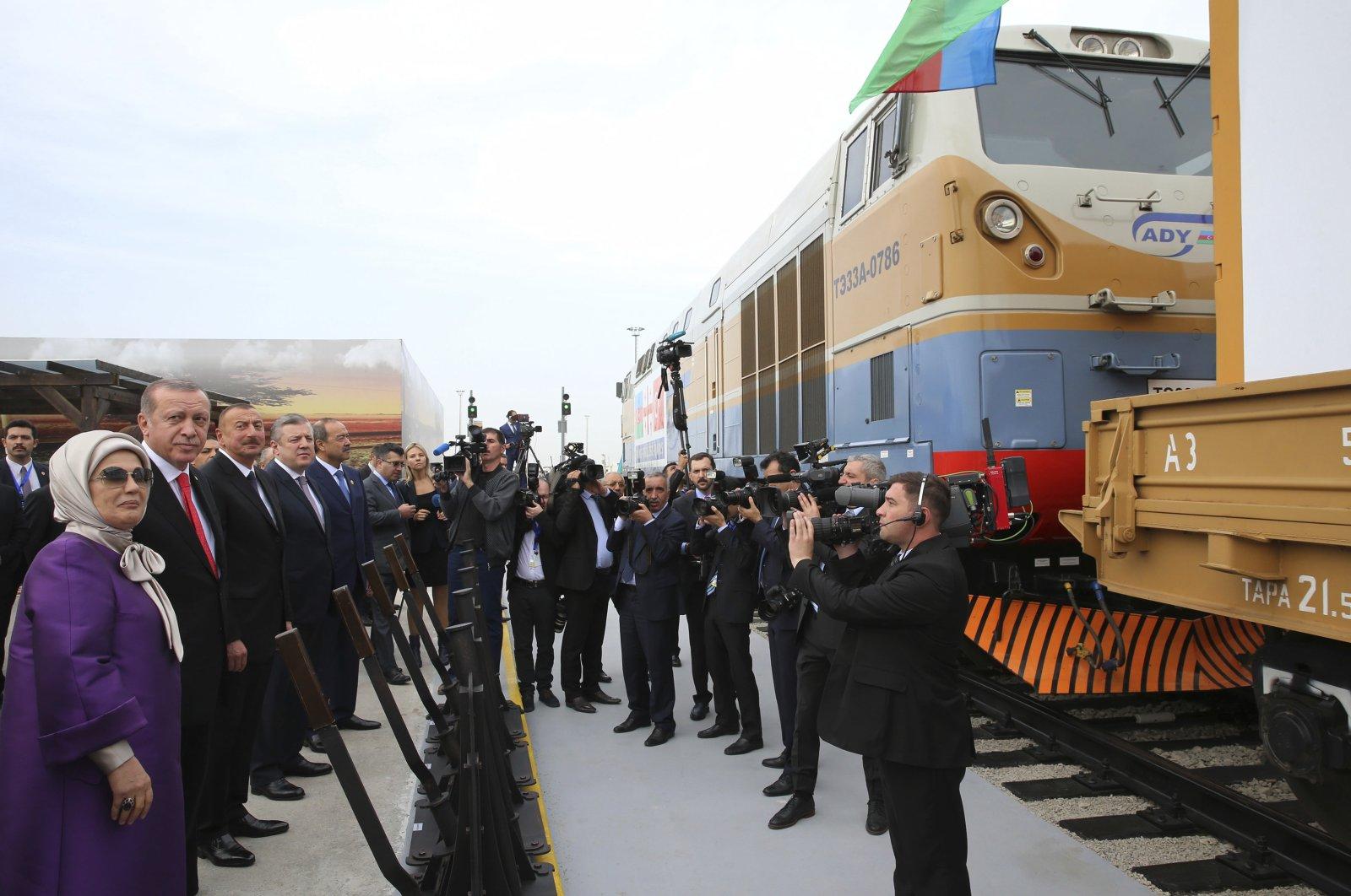 Turkey's President Recep Tayyip Erdoğan, (2nd L), accompanied by his wife, Emine, (L), Azerbaijan's President Ilham Aliyev, (3rd L) and Georgia's Prime Minister Giorgi Kvirikashvili, (4th L), inaugurate the Baku-Tbilisi-Kars railway, at a ceremony in Baku, Azerbaijan, Oct. 30, 2017. (Pool Photo via AP)