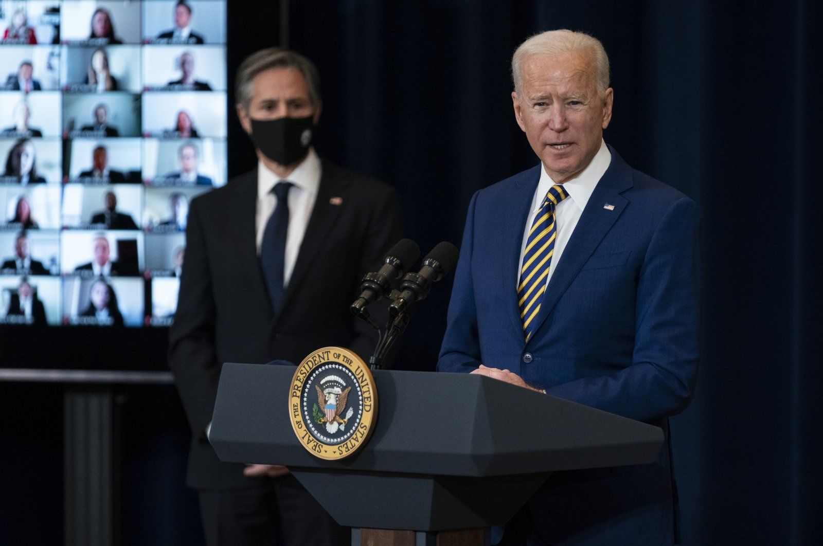 U.S. Secretary of State Antony Blinken listens as U.S. President Joe Biden delivers remarks to State Department staff, Washington, D.C., the U.S., Feb. 4, 2021. (AP Photo)