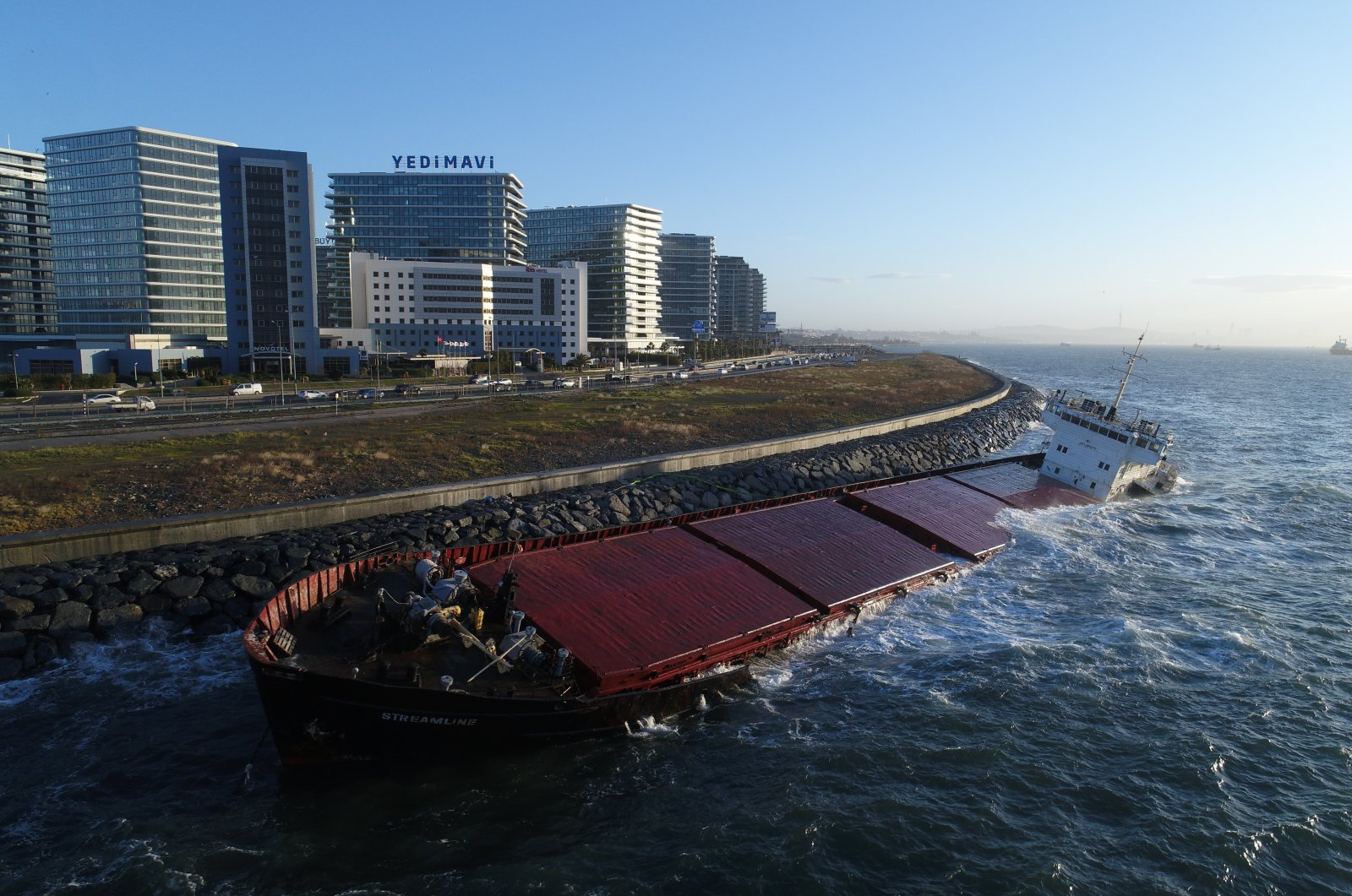 A cargo ship that ran aground on Jan. 29,2021 is seen in the aftermath of a storm, off the coast of Zeytinburnu district, Istanbul, Turkey. (IHA Photo)