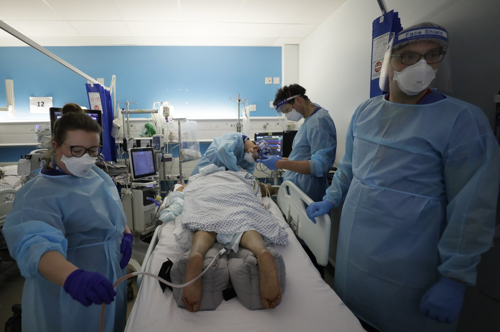 In this Wednesday, Jan. 27, 2021 file photo, Critical Care staff look after a COVID-19 patient on the Christine Brown ward at King's College Hospital in London. (AP Photo)