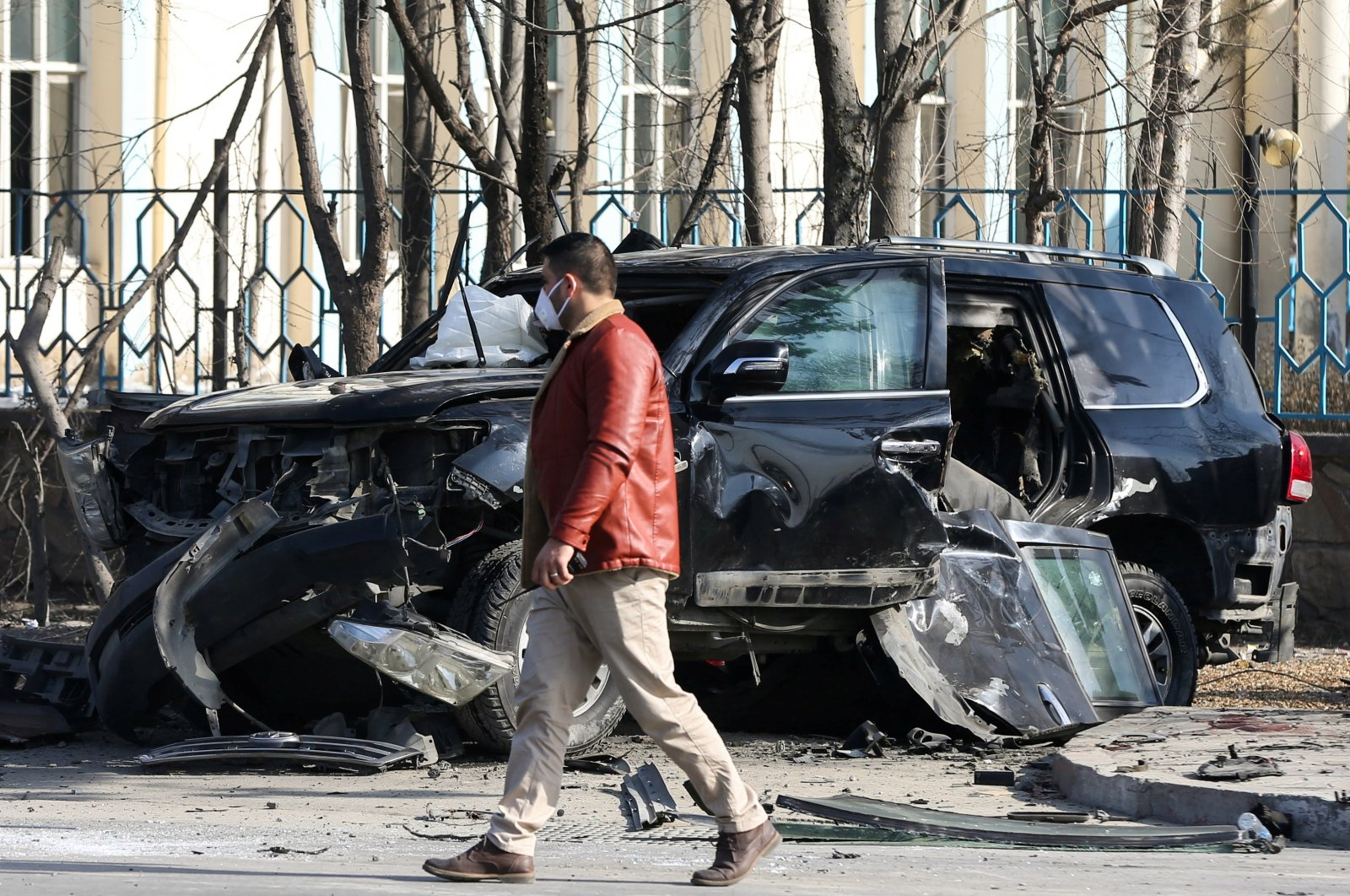 An Afghan security official inspects the site of a bomb blast in Kabul, Afghanistan Feb. 9, 2021. (Reuters Photo)