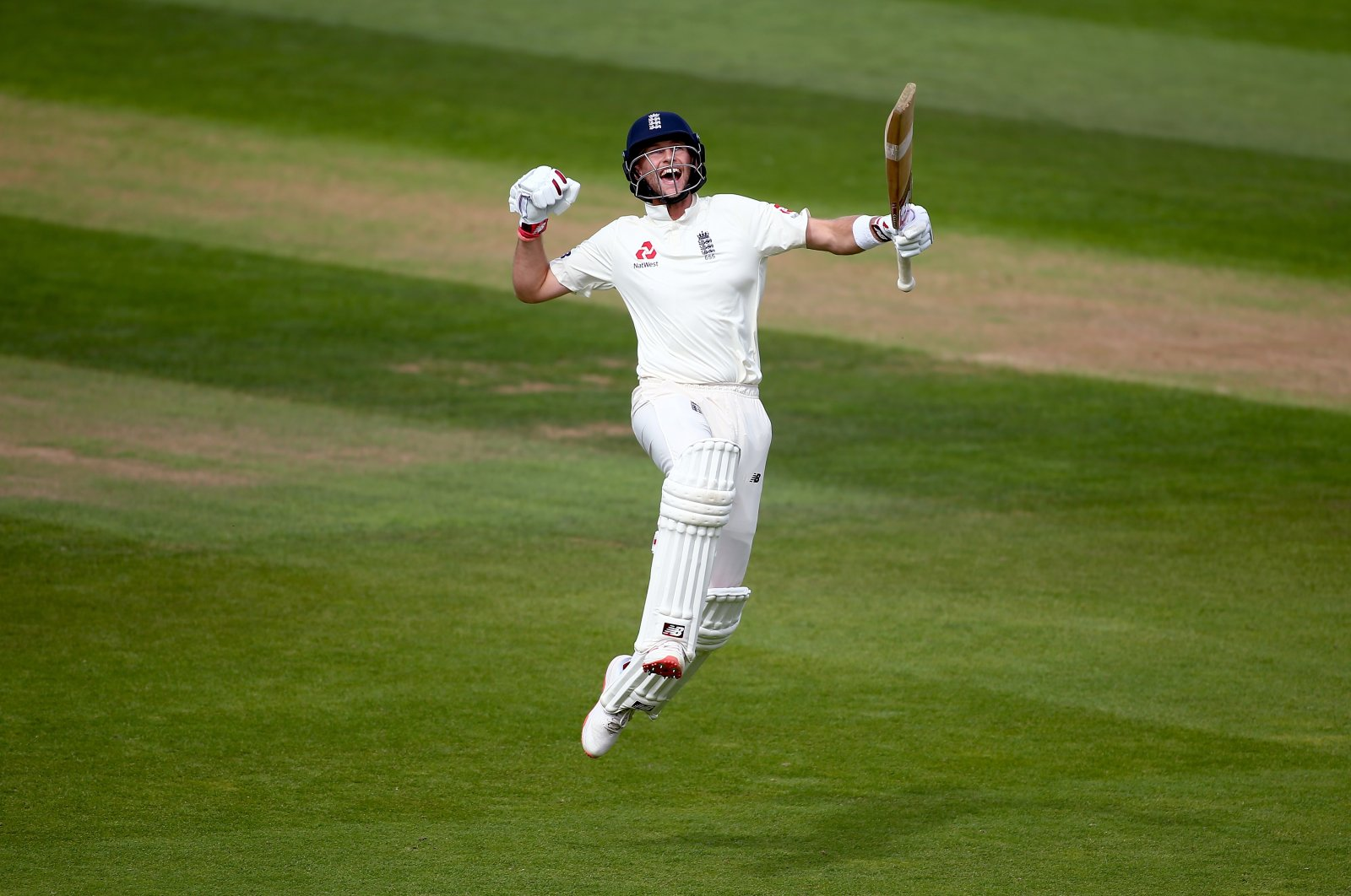 England's Joe Root celebrates his century during day four of the fifth Test match between England and India at the Kia Oval in London, England, Sept. 10, 2018. (Getty Images)