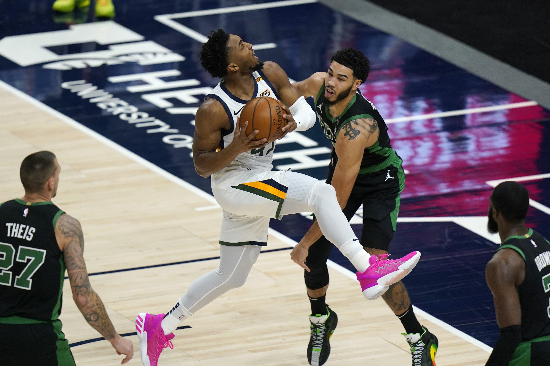 Utah Jazz guard Donovan Mitchell (L) goes to the basket as Boston Celtics forward Jayson Tatum (R) defends during an NBA game, in Salt Lake City, Feb. 9, 2021. (AP Photo)