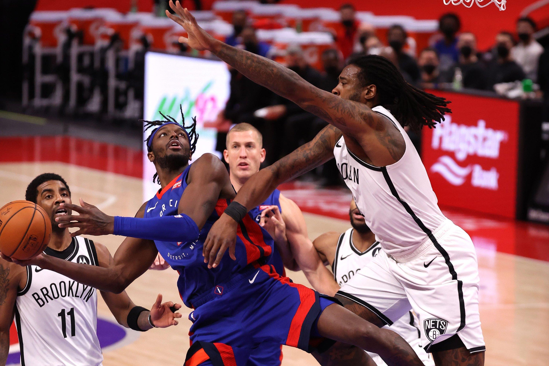 Detroit Pistons' Jerami Grant (C) tries to get a shot past DeAndre Jordan (R) of the Brooklyn Nets at Little Caesars Arena, in Detroit, Michigan, Feb. 9, 2021. (AFP Photo)