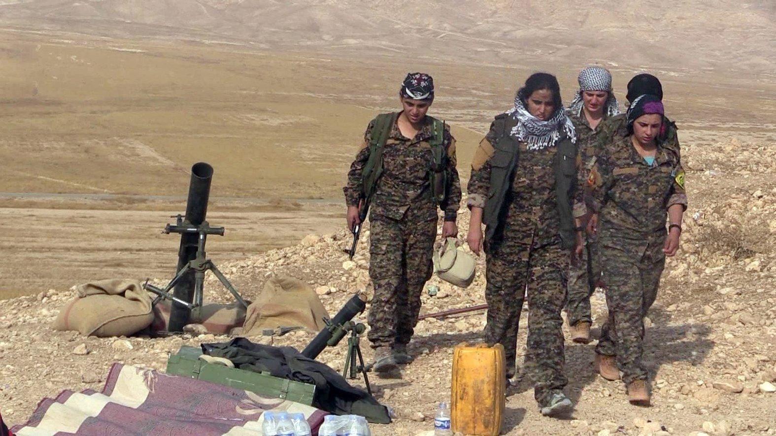 This undated photo shows a group of PKK terrorists in Sinjar, Iraq. (IHA Photo)