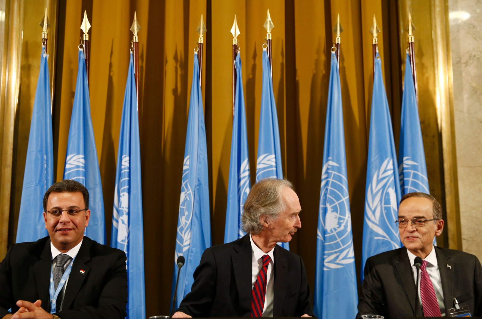 U.N. Special Envoy to Syria Geir Pedersen (C), co-chair Syrian parliament member Ahmad Al-Kuzbari (L) and opposition co-chair Hadi Al-Bahra attend a ceremony to mark the opening of a meeting of the Syrian constitution-writing committee, at the United Nations Offices in Geneva, Switzerland, Oct. 30, 2019. (AFP Photo)
