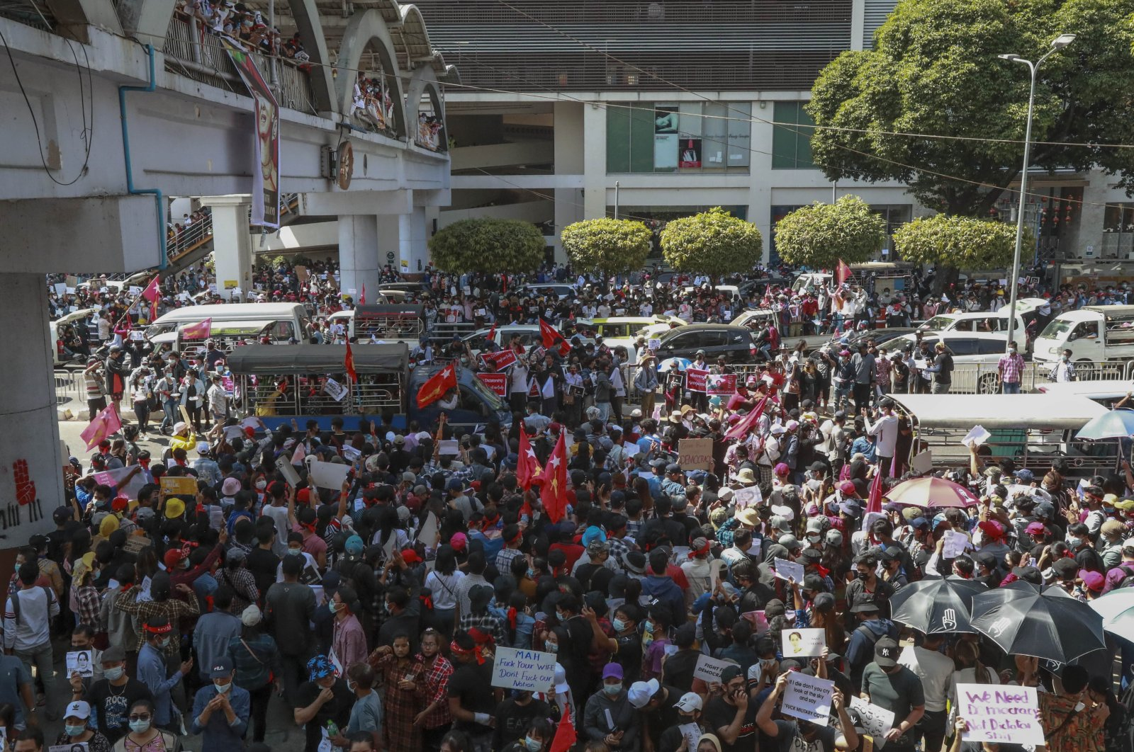 Demonstrators gather to demand the release of detained Myanmar State Counselor Aung San Suu Kyi in Yangon, Myanmar, Feb. 9, 2021. (AP Photo)