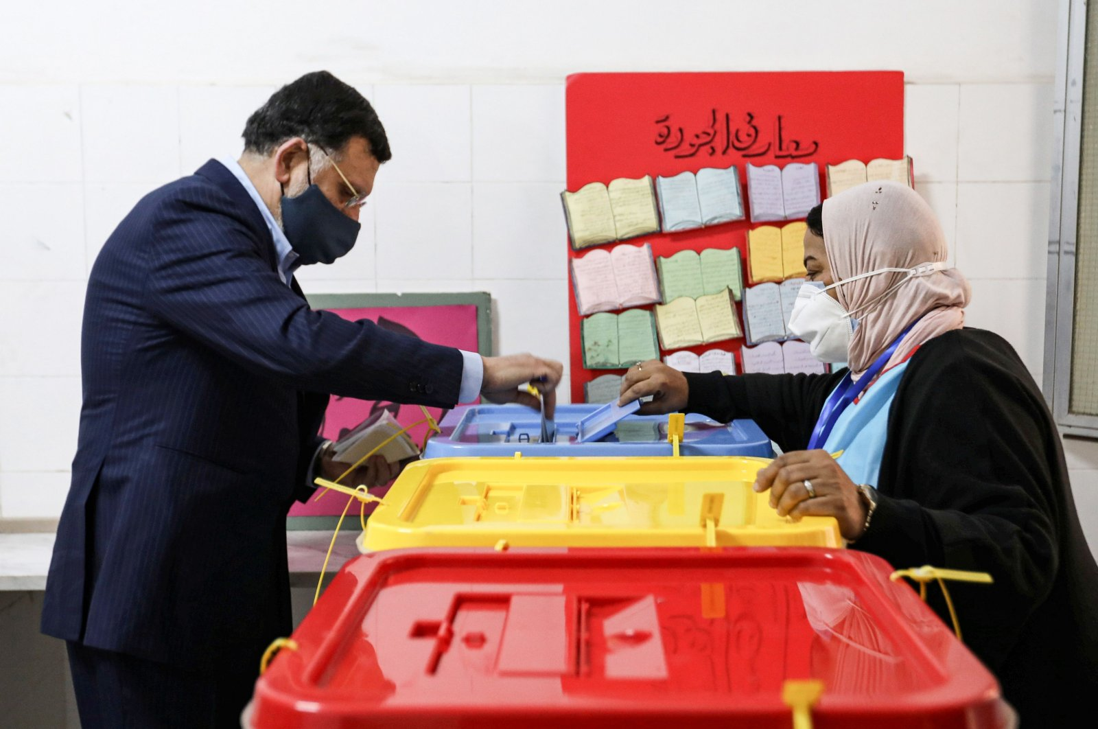 Fayez Sarraj, outgoing prime minister of the UN-recognized Libyan Government of National Accord (GNA), casts his vote during an election for the Tripoli Municipal Council, in Libya's capital on Feb. 6, 2021. (AFP Photo)