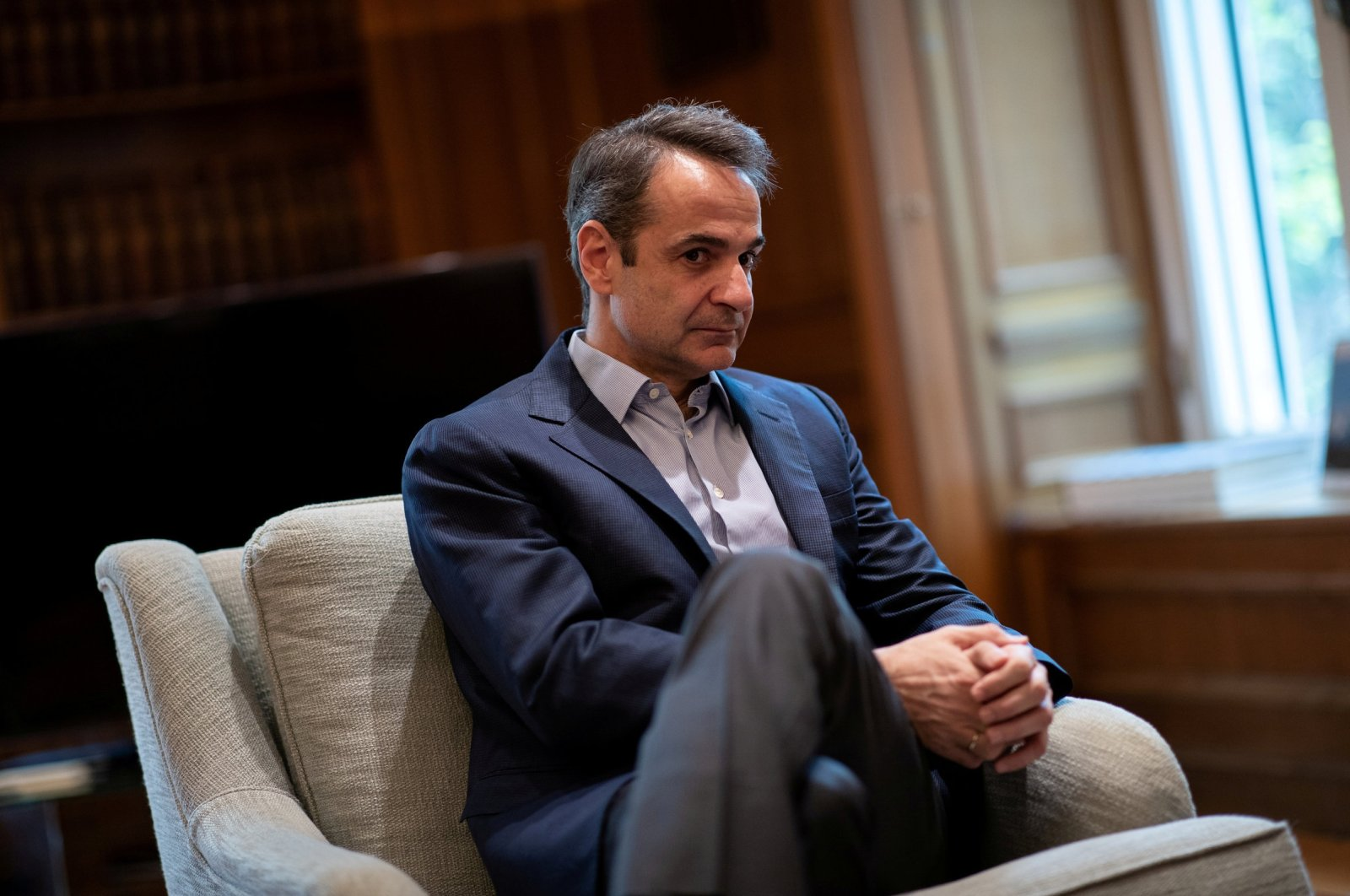 Greek Prime Minister Kyriakos Mitsotakis looks on before his meeting with Managing Director of the European Stability Mechanism Klaus Regling in his office in the Maximos Mansion in Athens, Greece, March 7, 2020. (REUTERS)