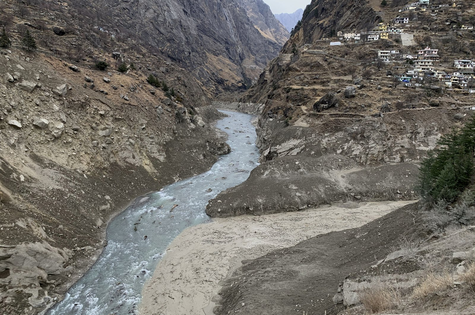 Muddy water flows into Alaknanda river two days after a part of a Himalayan glacier broke off sending a devastating flood downriver in Tapovan area of the northern state of Uttarakhand, India, Tuesday, Feb. 9, 2021. (AP Photo)