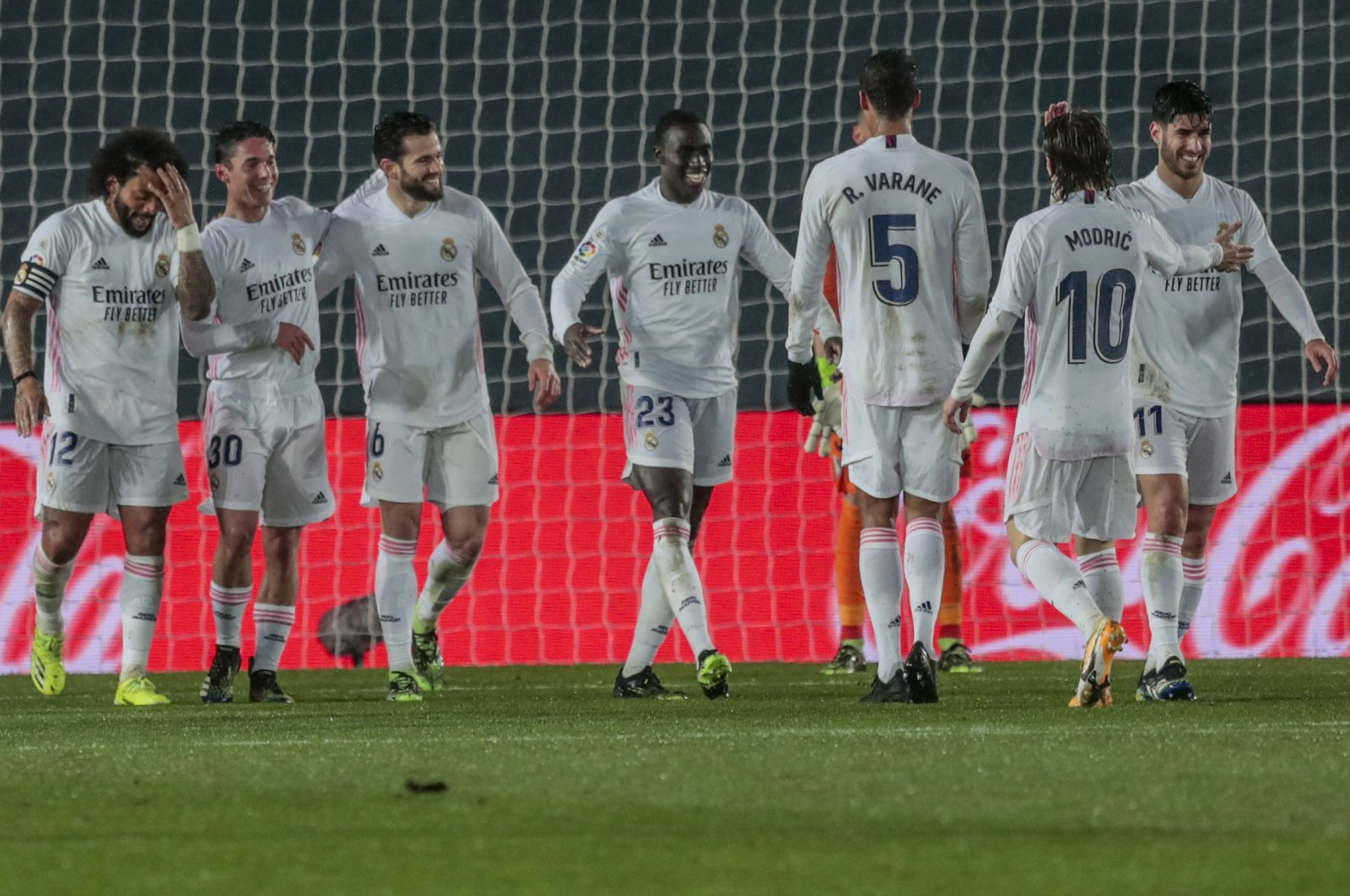 Real Madrid's Ferland Mendy (C) celebrates after scoring his side's second goal during a La Liga match against Getafe at Alfredo di Stefano Stadium, Madrid, Spain, Feb. 9, 2021. (AP Photo)
