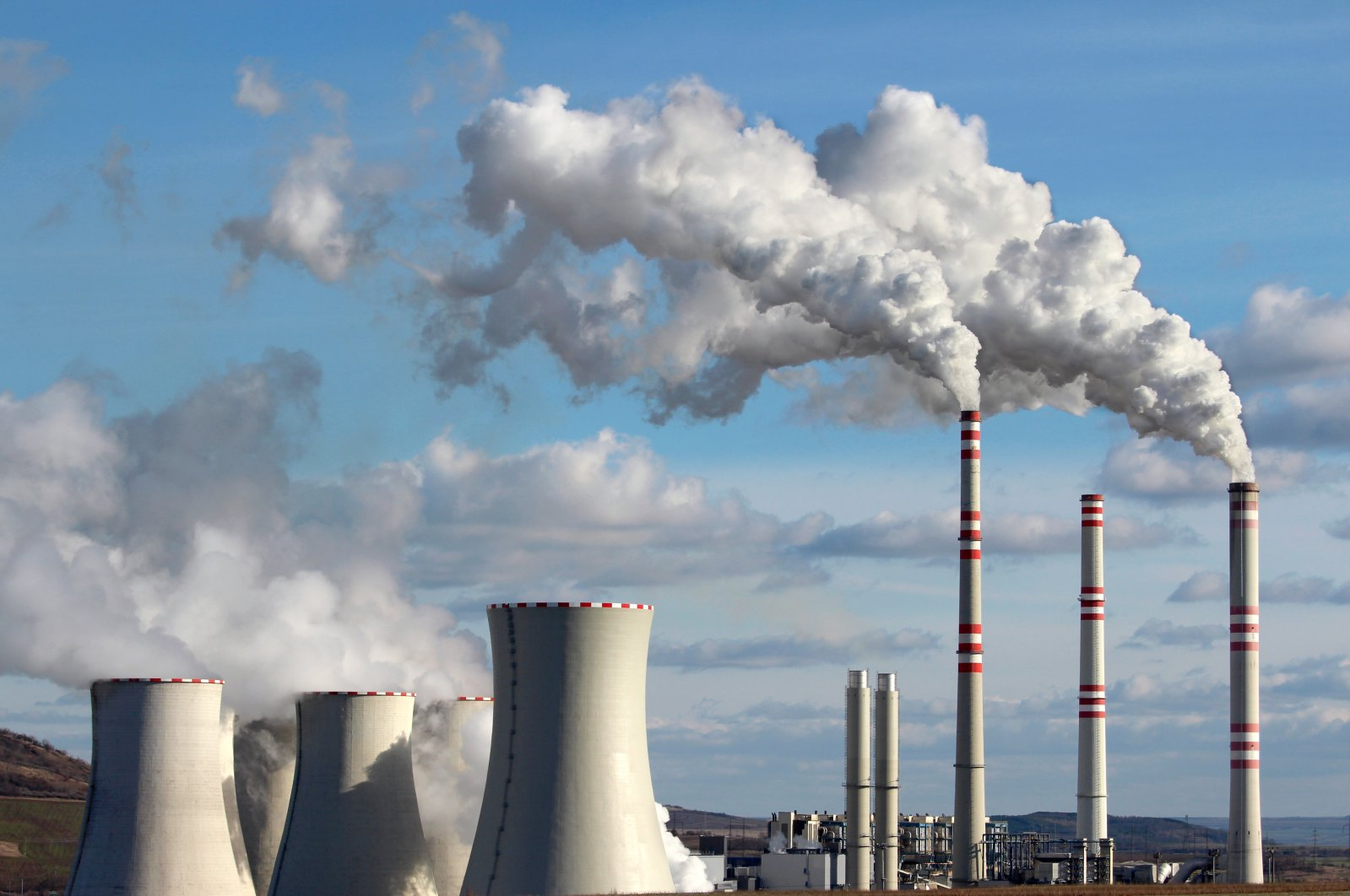 White smoke is emitted from a coal power plant. (Shutterstock Photo)