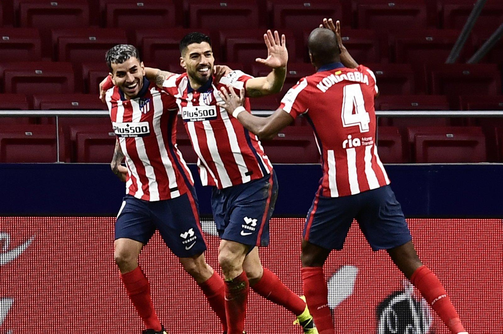 Atletico Madrid's Luis Suarez (C) celebrates with teammates after scoring against Celta at the Wanda Metropolitano Stadium, Madrid, Spain, Feb. 8, 2021. (AP Photo)