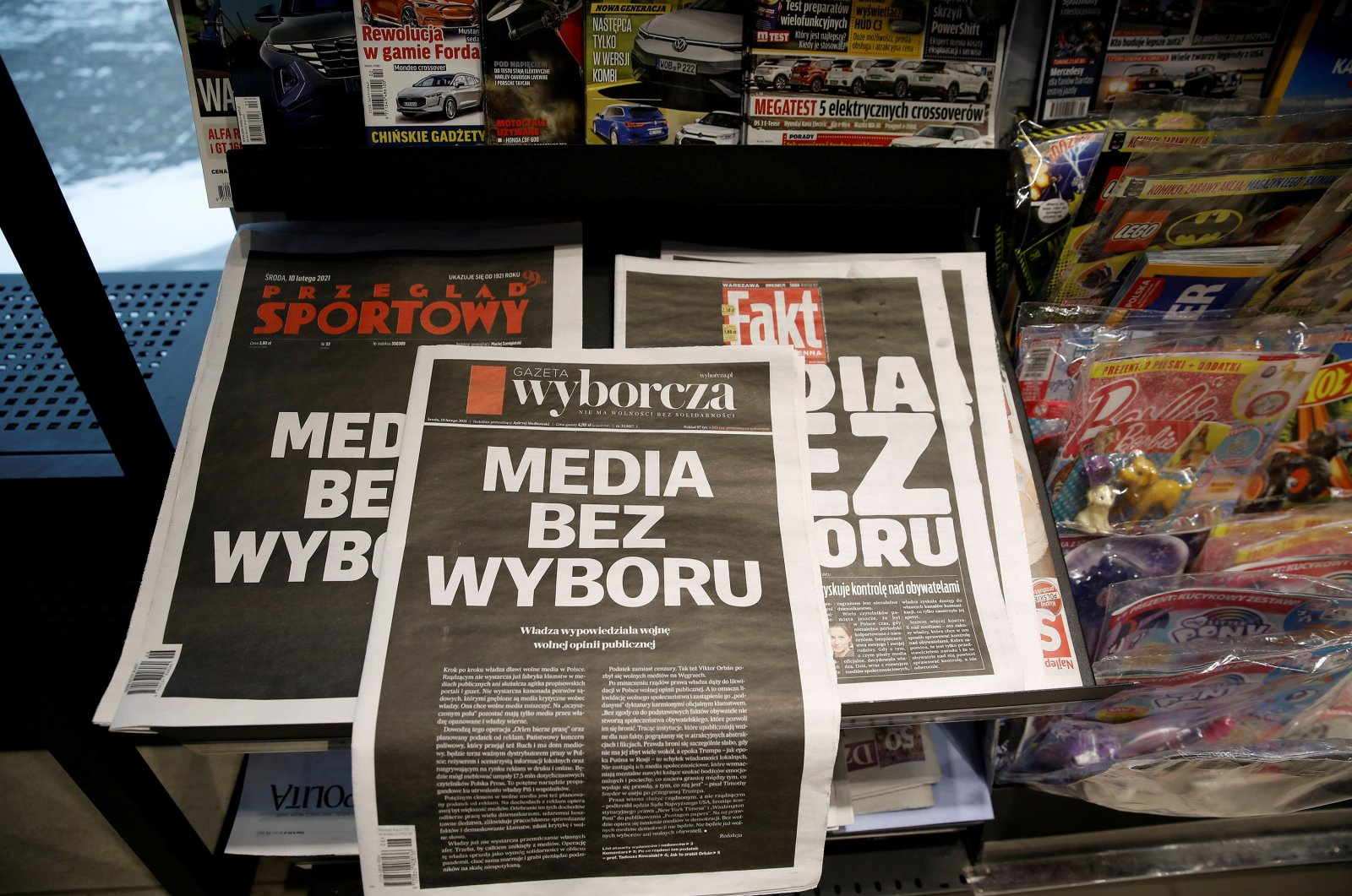 """The first pages of Poland's main private newspapers featuring black front pages with the slogan """"Media without choice"""", Warsaw, Poland Feb. 10, 2021. (Reuters)"""