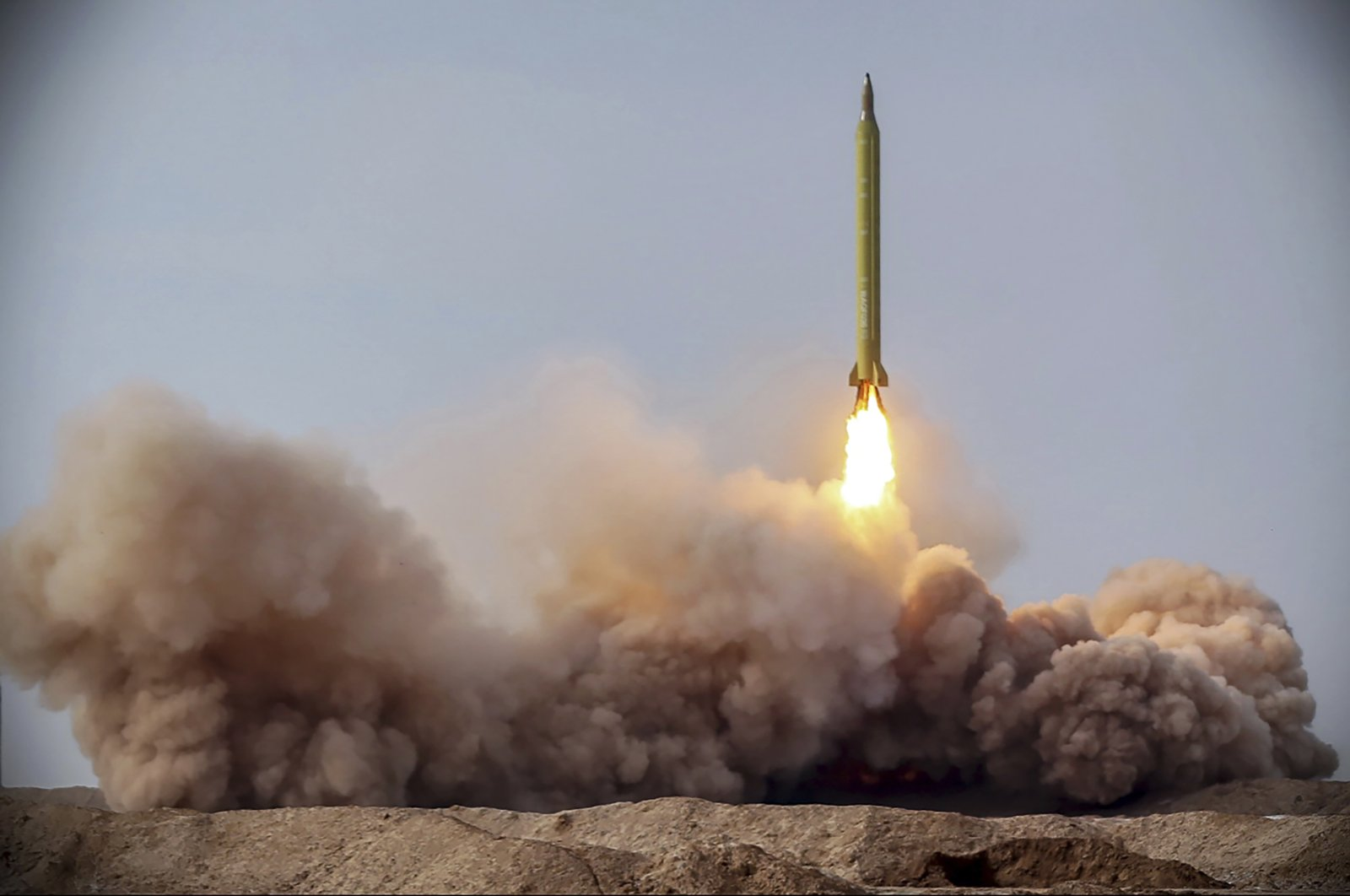 In this file photo released Jan. 16, 2021, by the Iranian Revolutionary Guard, a missile is launched in a drill in Iran. On Tuesday, Jan. 26, 2021, Iran warned the Biden administration that it will not have an indefinite time period to rejoin the 2015 nuclear deal between Tehran and world powers. (Iranian Revolutionary Guard via AP)