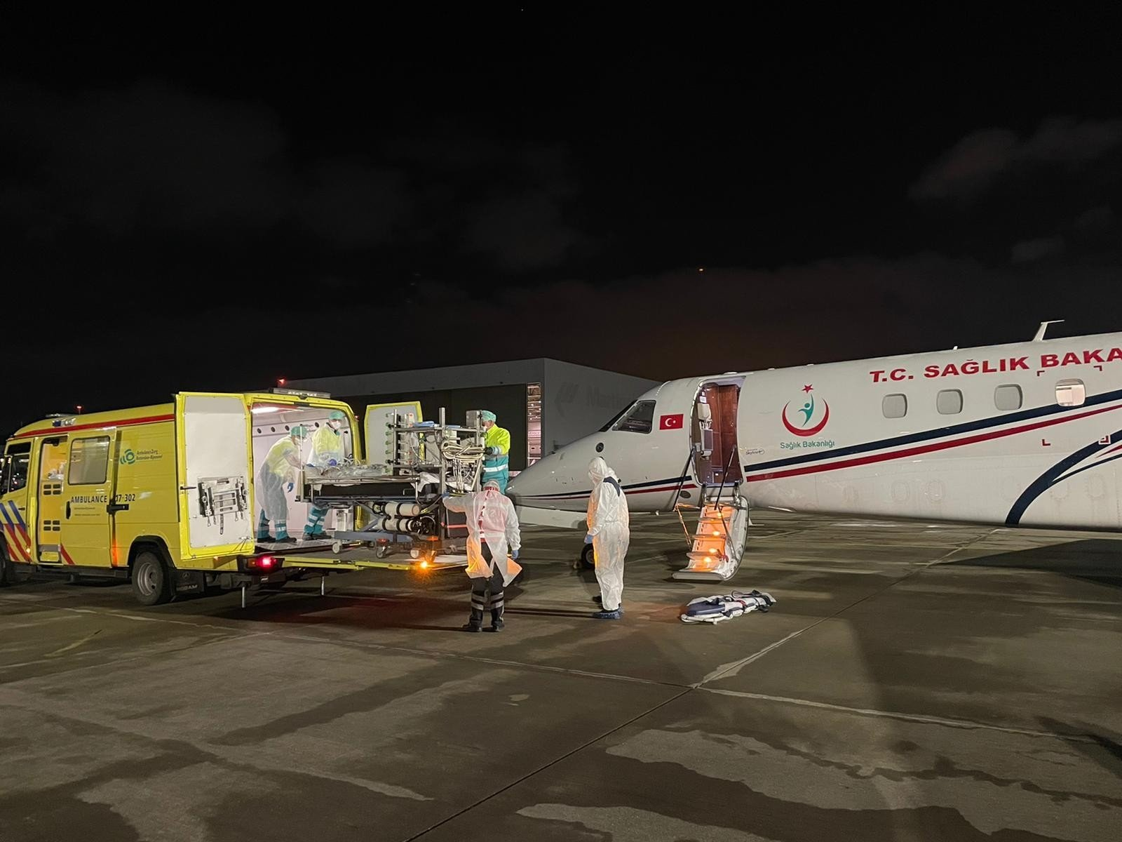 Selahattin Kandaz is transported to a Turkish air ambulance at Schiphol Airport, in Amsterdam, Netherlands, Feb. 10, 2021. (IHA Photo)