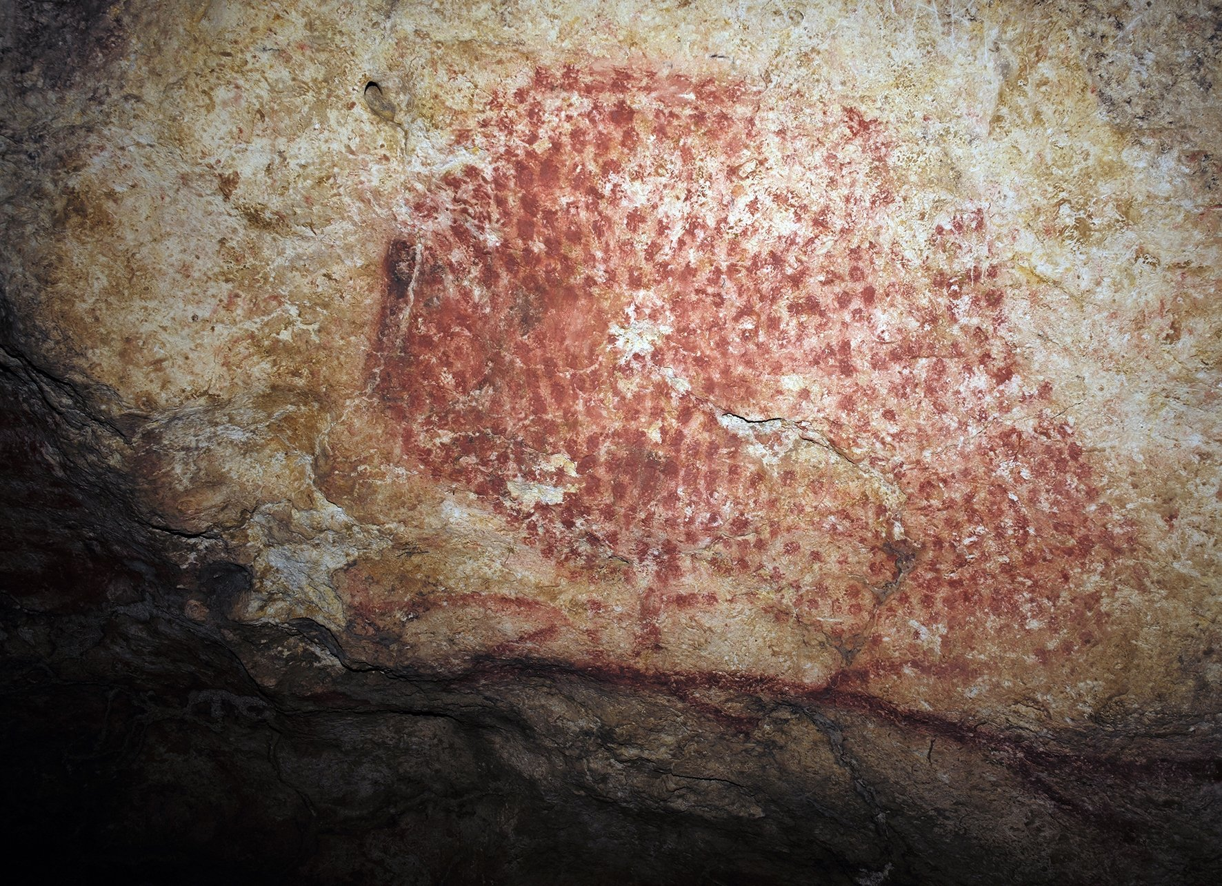 This photo provided by researcher Carole Fritz in February 2021 shows the prehistoric wall painting, near which the shell was found. (AP PHOTO)