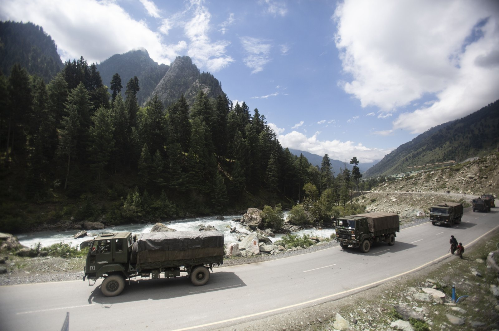 An Indian army convoy moves on the Srinagar-Ladakh highway toward the cold-desert Ladakh region where China and India have been engaged in a tense standoff since May, at Gagangeer, northeast of Srinagar, Indian-controlled Kashmir, Sept. 1, 2020.  (AP Photo)