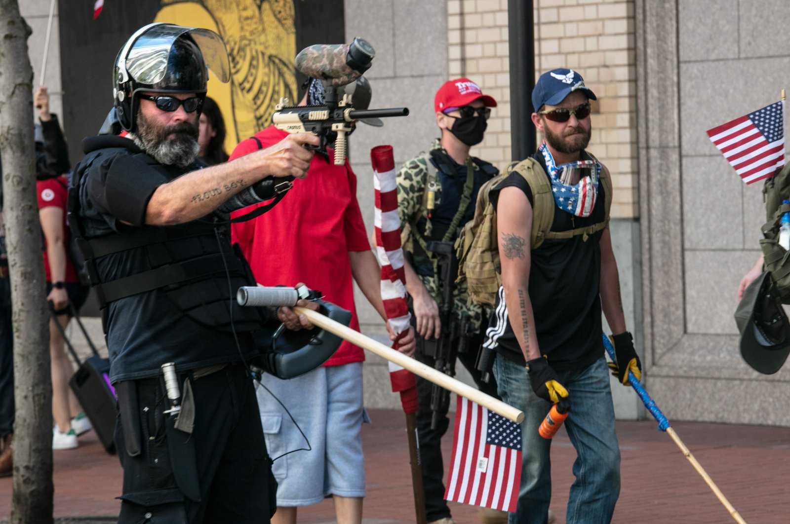 The Proud Boys face off against Black Lives Matter protesters using mace and a paintball gun, in downtown Portland, Oregon, U.S., Aug. 15, 2020. (Photo by Getty Images)