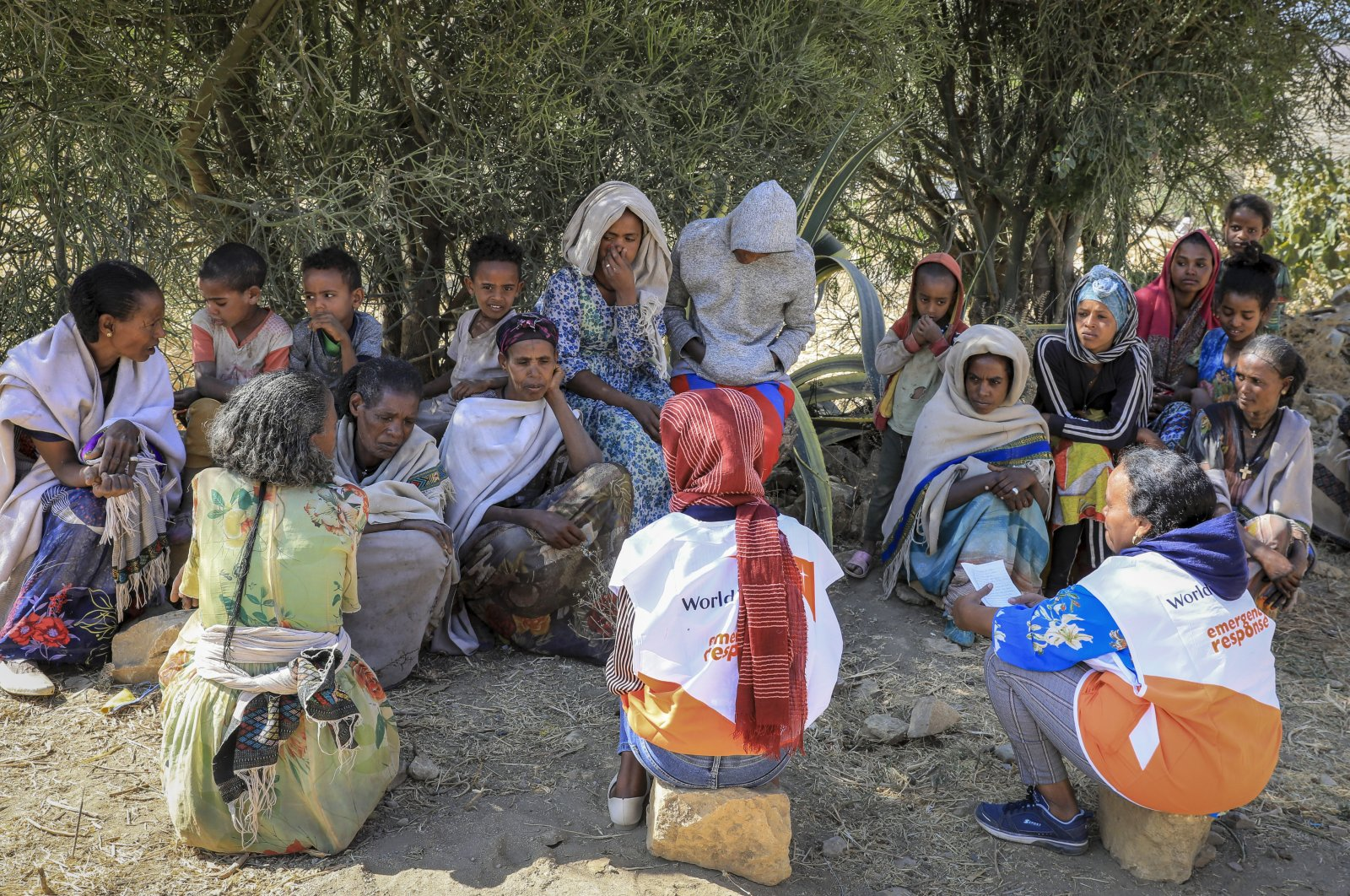 Displaced people speak to a community assessment team from World Vision, in the Enderta district of the Tigray region of northern Ethiopia, Jan. 15, 2021. (AP Photo)