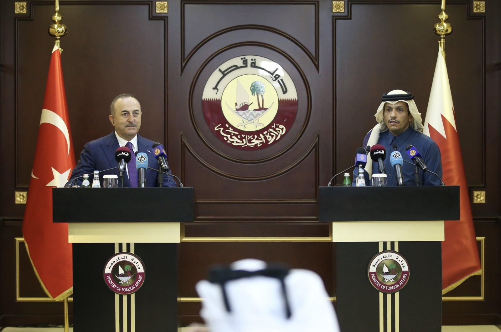 Foreign Minister Mevlüt Çavuşoğlu at a news conference with his Qatari counterpartSheikh Mohammed bin Abdulrahman Al Thani in Doha, Qatar, Feb. 11, 2021. (AA Photo)