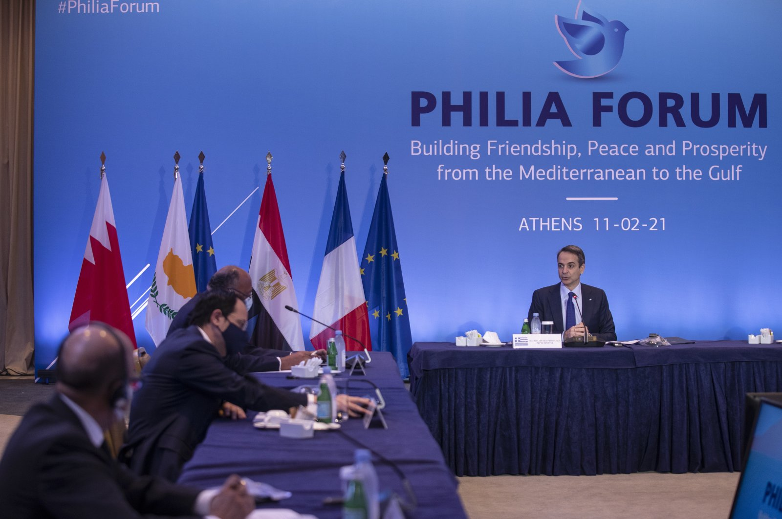 From left, Bahrain's Foreign Minister Abdullatif Al-Zayani, Greek Cypriot Foreign Minister Nicos Christodoulides and Egyptian Foreign Minister Sameh Shoukry listen to Greek Prime Minister Kyriakos Mitsotakis' (R) speech during a meeting in Athens, Greece, Feb. 11, 2021. (AP Photo)