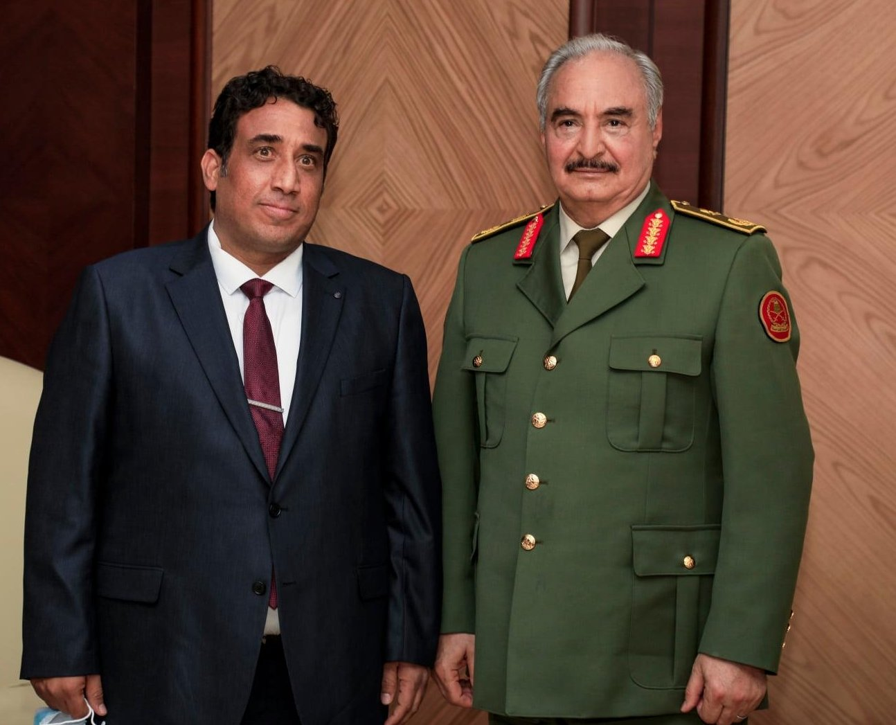 The president of Libya's recently elected transitional government, Mohammed Menfi (L), meets with putschist Gen. Khalifa Haftar in Benghazi, eastern Libya, Feb. 11, 2021 (AA Photo)