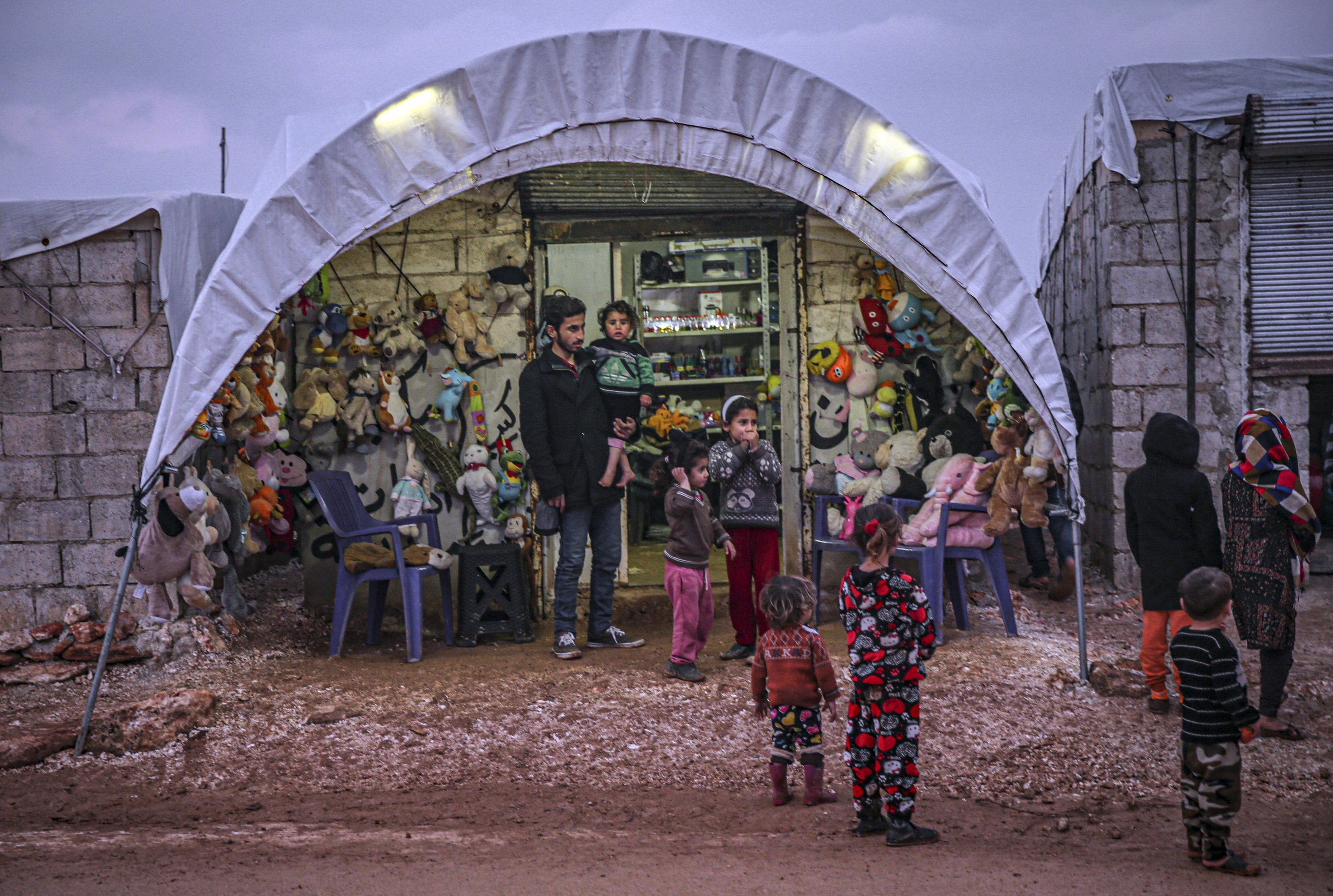 Muhammed Quteish, a Syrian who was displaced by the Bashar Assad regime, has opened a toy shop in northwestern Idlib province, Syria, Feb. 12, 2021. (AA Photo)