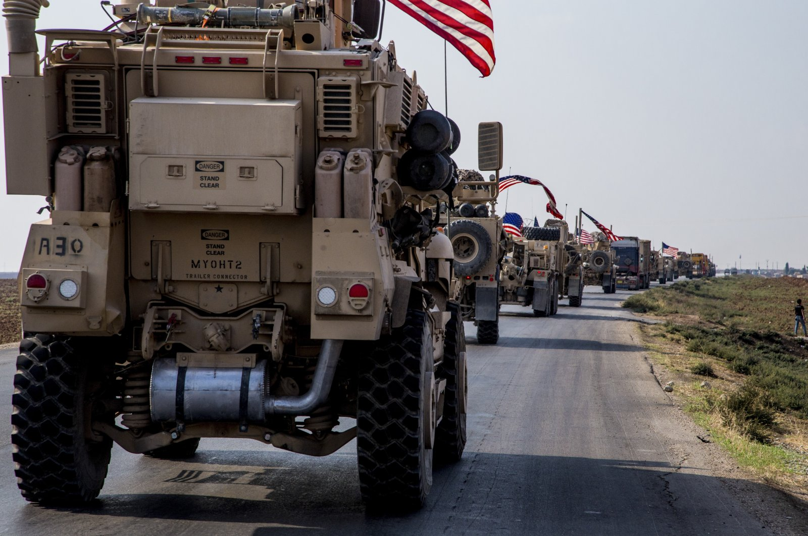 A U.S. military convoy drives near the town of Qamishli, northern Syria, Oct. 26, 2019. (AP File Photo)