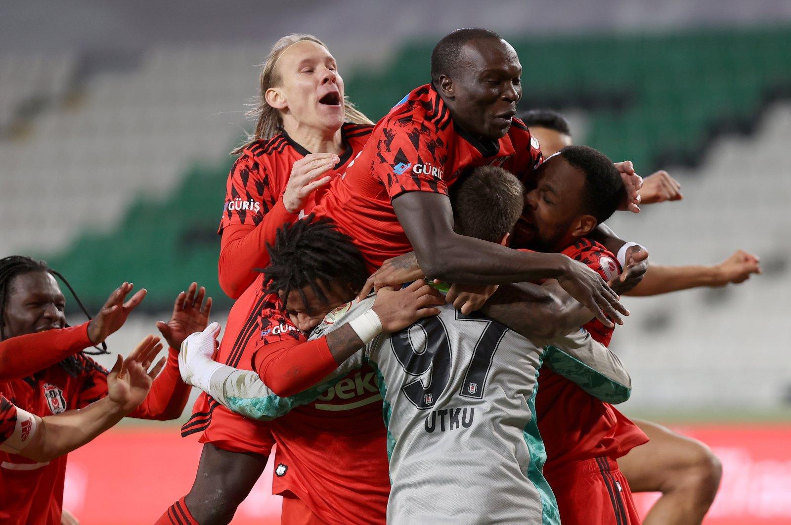Beşiktaş players celebrate after defeating Konyaspor in the Ziraat Turkish Cup quarterfinals, in Konya, central Turkey, Feb. 11, 2021. (AA Photo)
