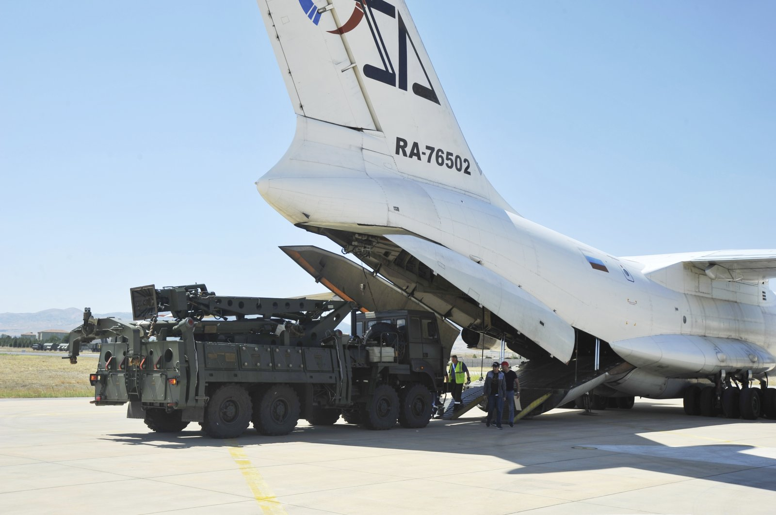 Military officials work around a Russian transport aircraft, carrying parts of the S-400 air defense systems, after it landed at Murted military airport outside Ankara, Turkey, Aug. 27, 2019. (Turkish Defense Ministry via AP, Pool)