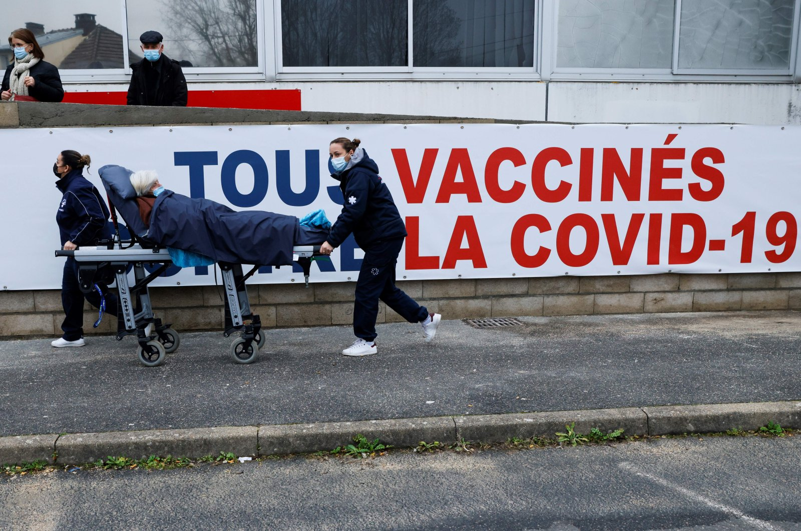 A woman is carried on a stretcher to the COVID-19 vaccination center at the South Ile-de-France Hospital Group in Melun, on the outskirts of Paris, France, Feb. 8, 2021. (EPA Photo)