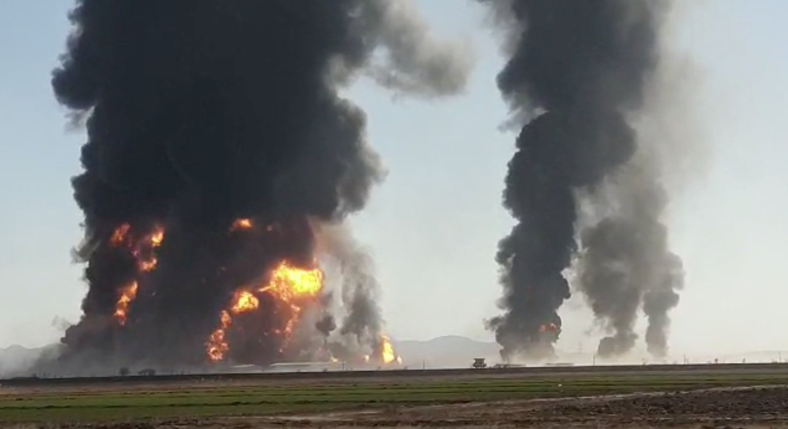 Fire and smoke rise from an explosion of a gas tanker in Herat, Afghanistan, Feb. 13, 2021. (Reuters)