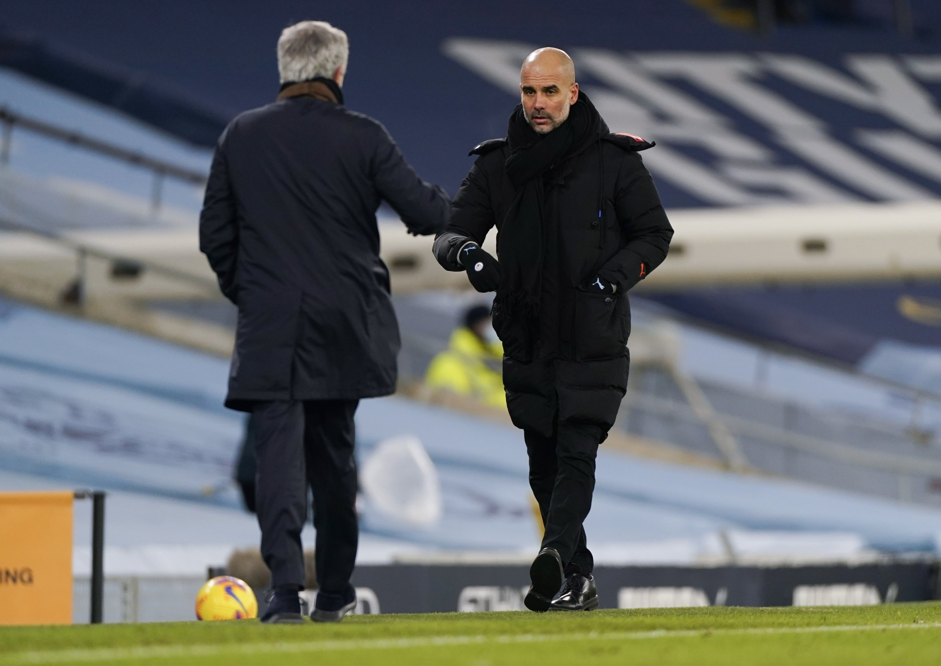 Pep Guardiola (R), manager of Manchester City and Jose Mourinho (L), manager of Tottenham congratulate each other at the end of the English Premier League soccer match between Manchester City and Tottenham Hotspur in Manchester, Britain, Feb. 13, 2021. (EPA Photo)