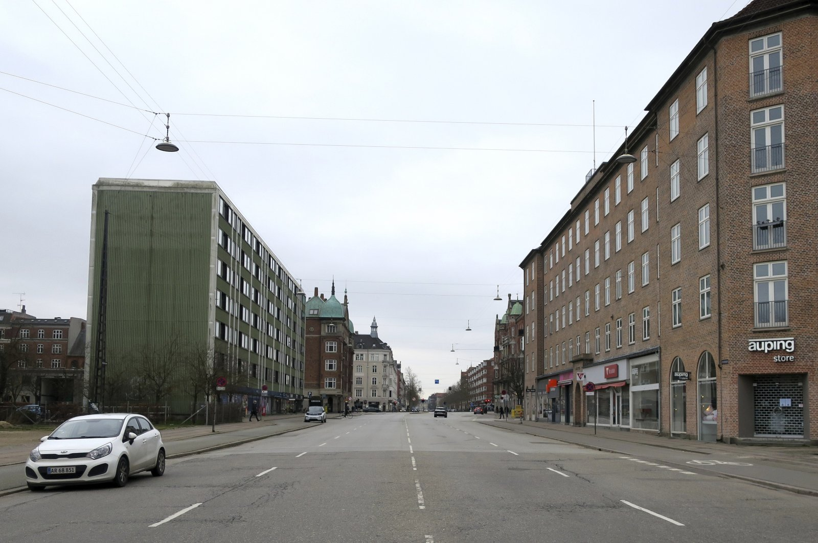 Oesterbrogade, a normally busy Copenhagen boulevard with lots of traffic is seen empty on Wednesday March 18, 2020. (AP Photos)