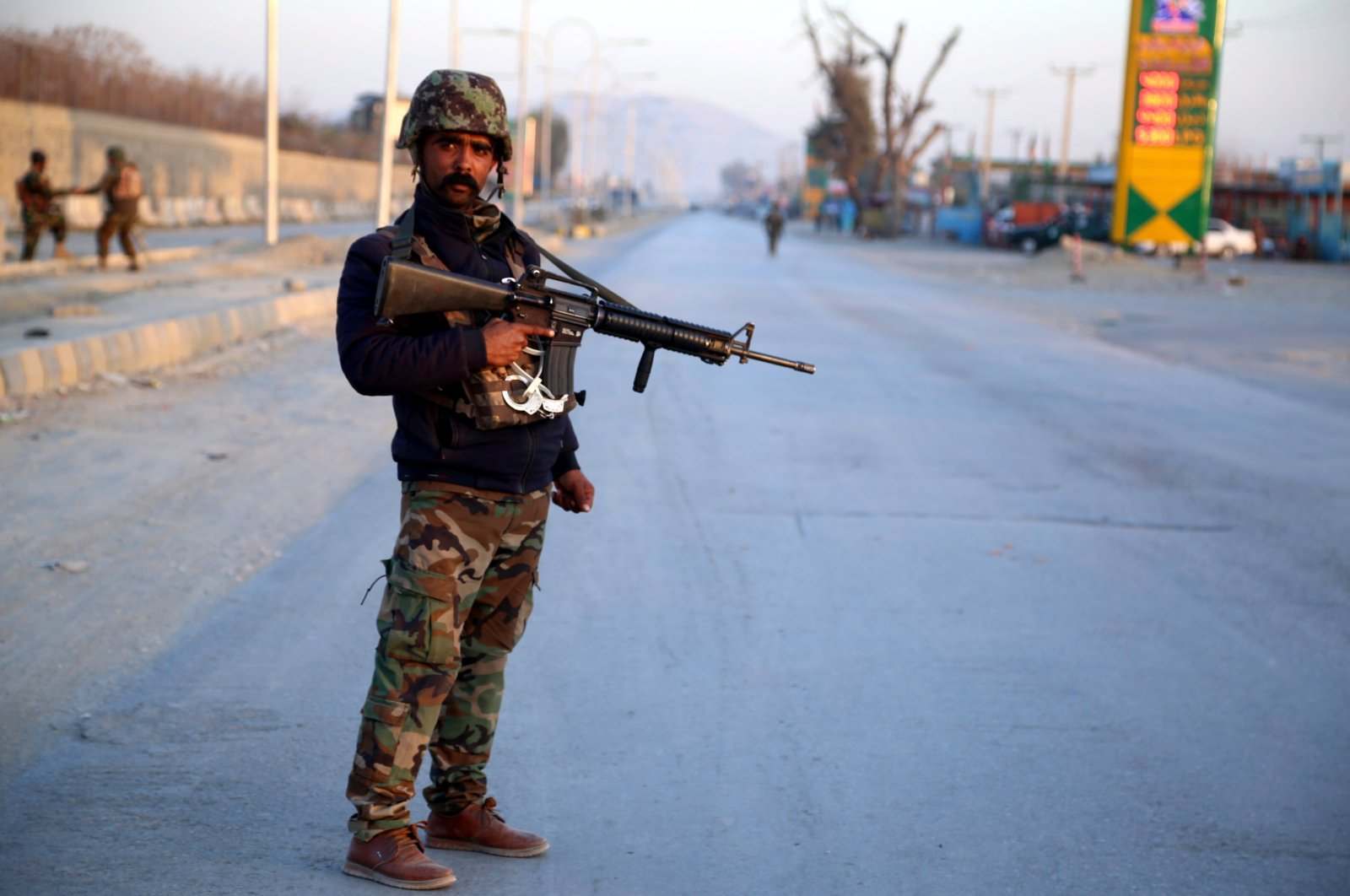An Afghan soldier stands guard at the scene of a bomb blast that targeted the vehicle of security officials in Jalalabad, Afghanistan, Feb. 11, 2021. (EPA Photo)
