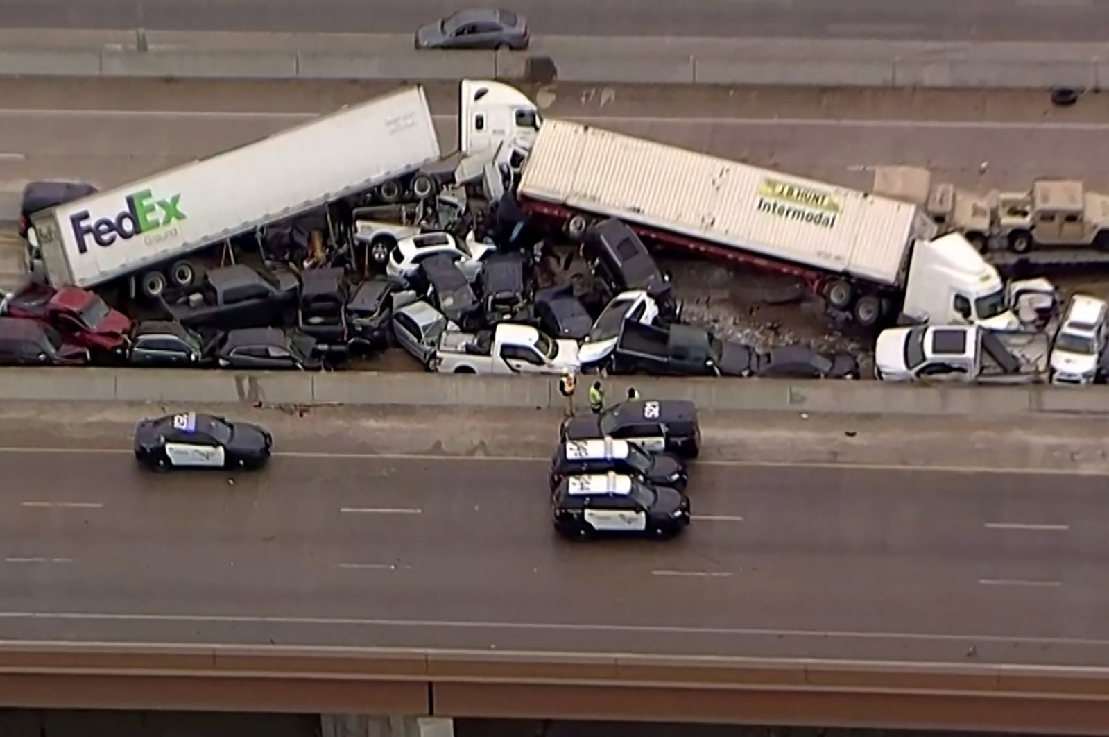 Cars and trucks are wedged together after a deadly multi-vehicle pileup on the ice-covered I-35 in a still image from video in Fort Worth, Texas, U.S. Feb.11, 2021. (Reuters Photo)